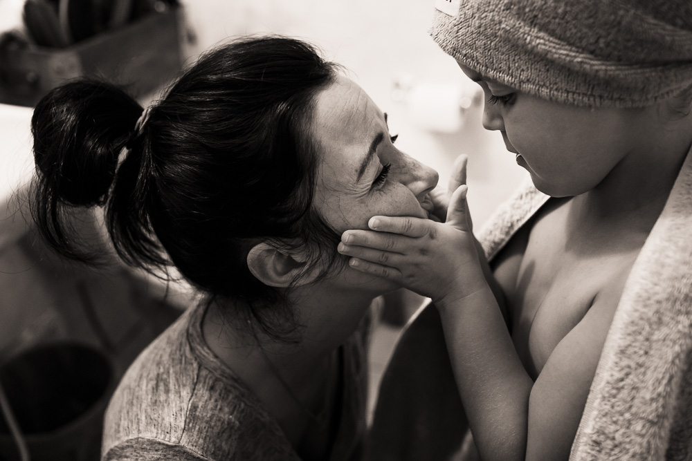 Girl squishing moms face
