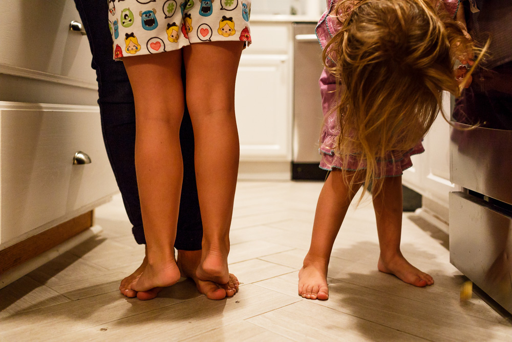 Daughter stepping on mommy's toes