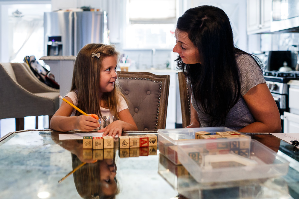 Supermom helping daughter with math.