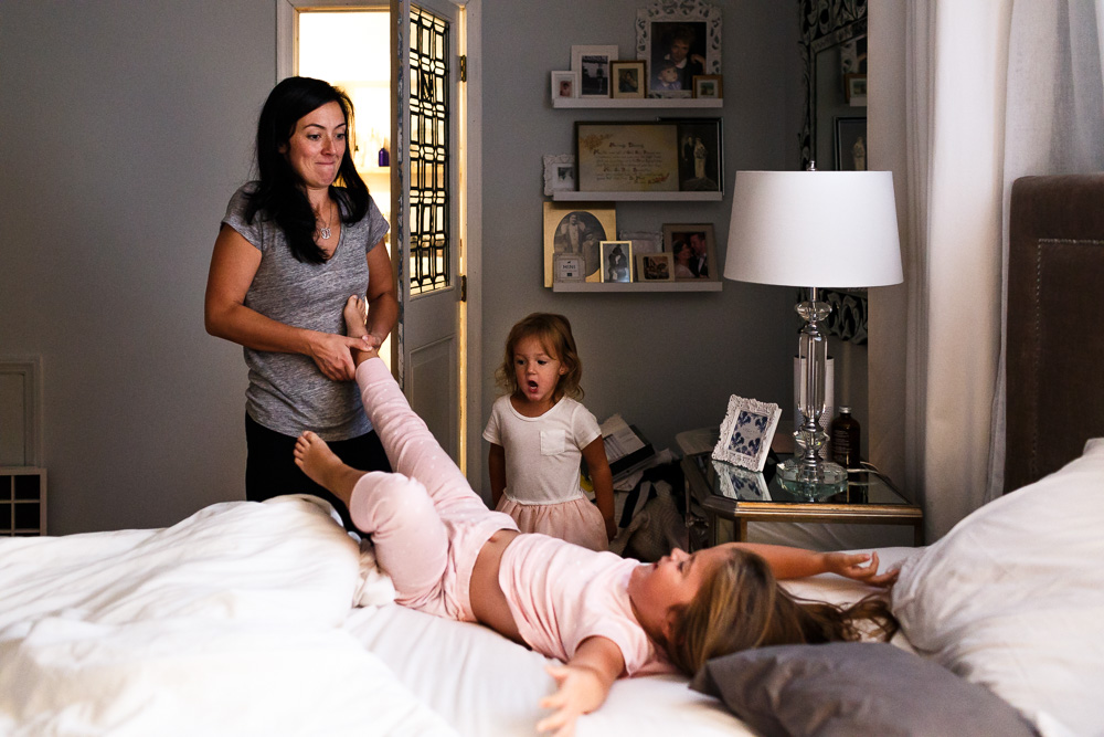 Mom pulling daughter out of bed!