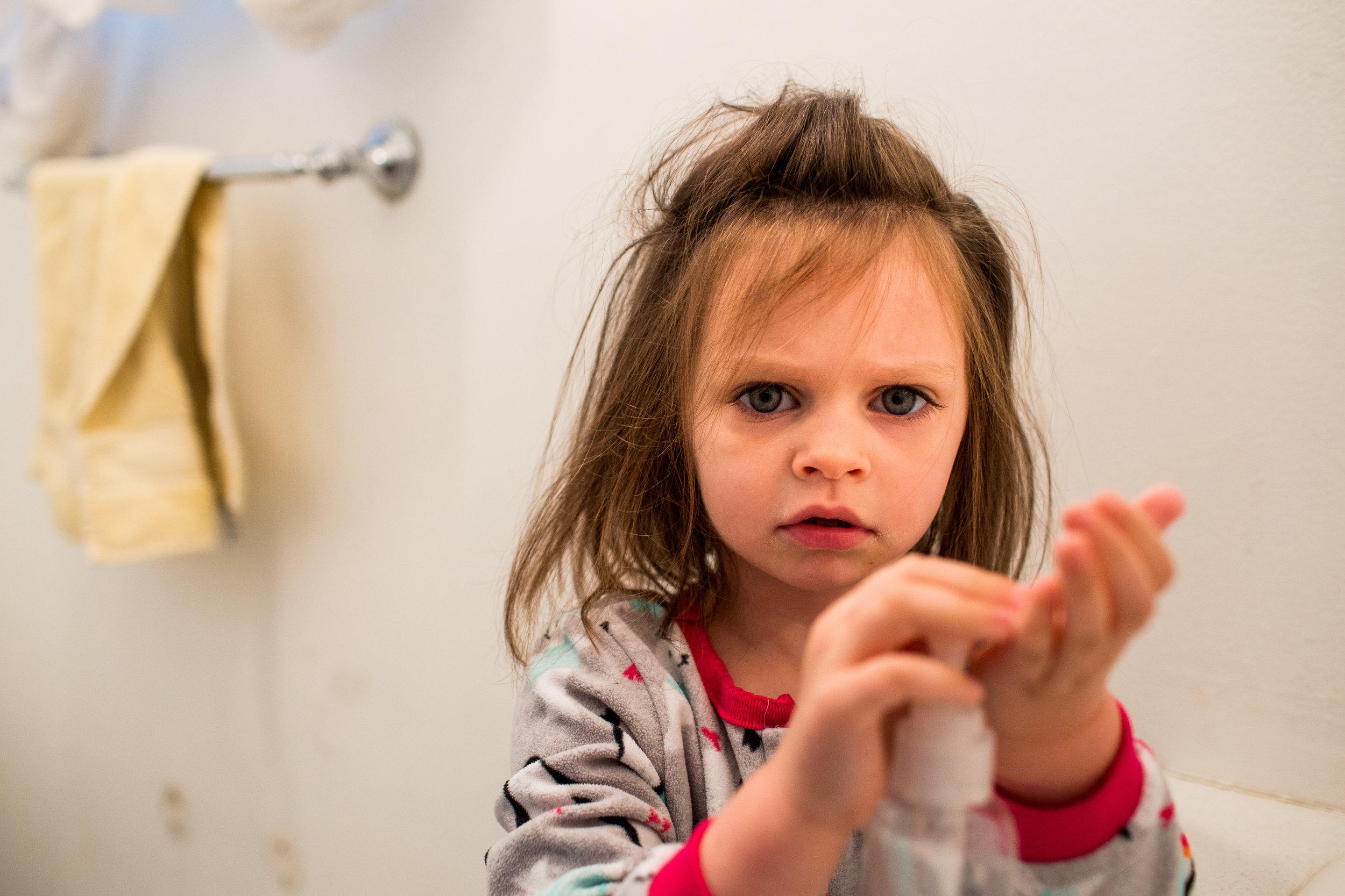 Little girl getting soap