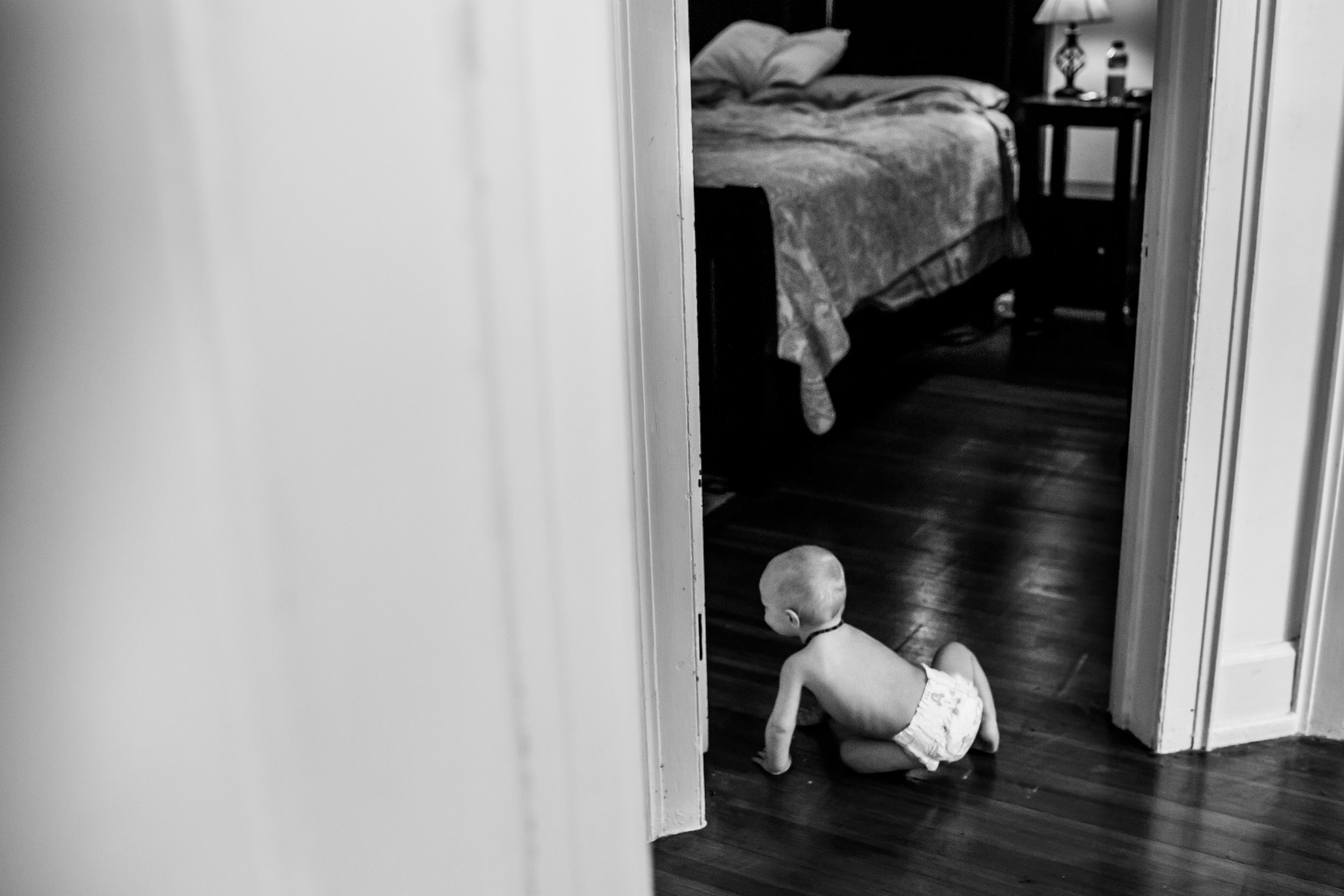 little girl crawling into her parents room