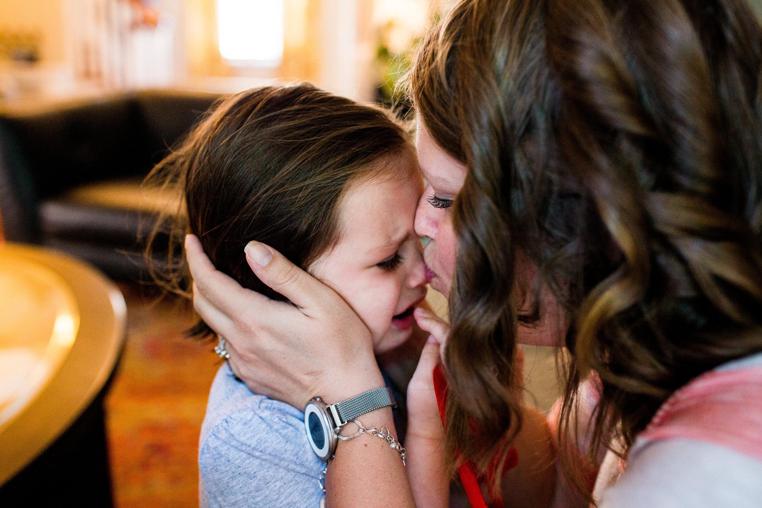 mom comforting little girl