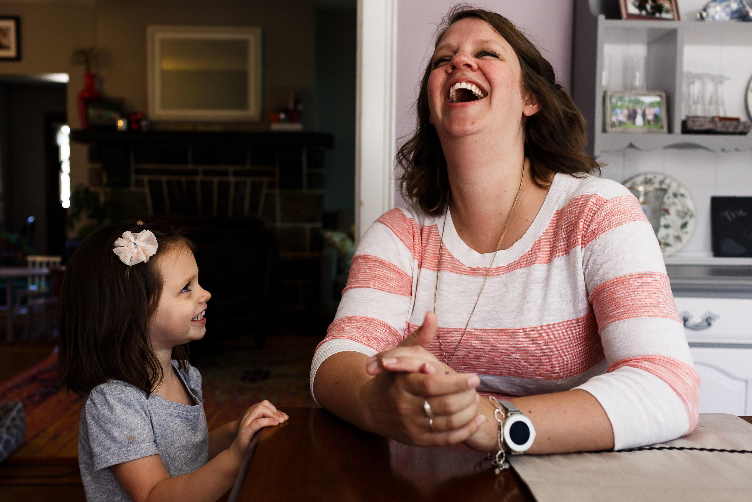daughter watching mom laugh