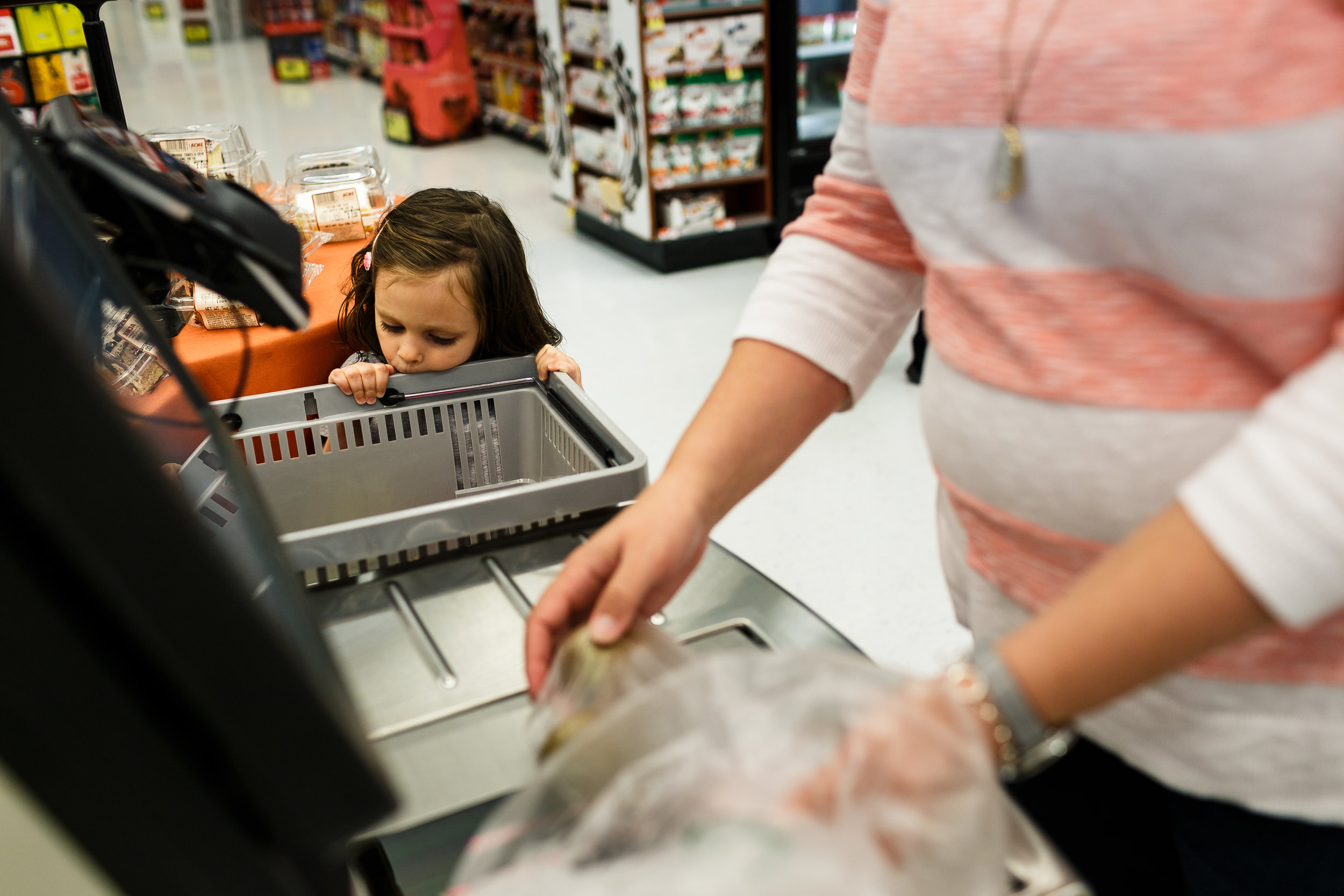 girl being bored at grocery checkout