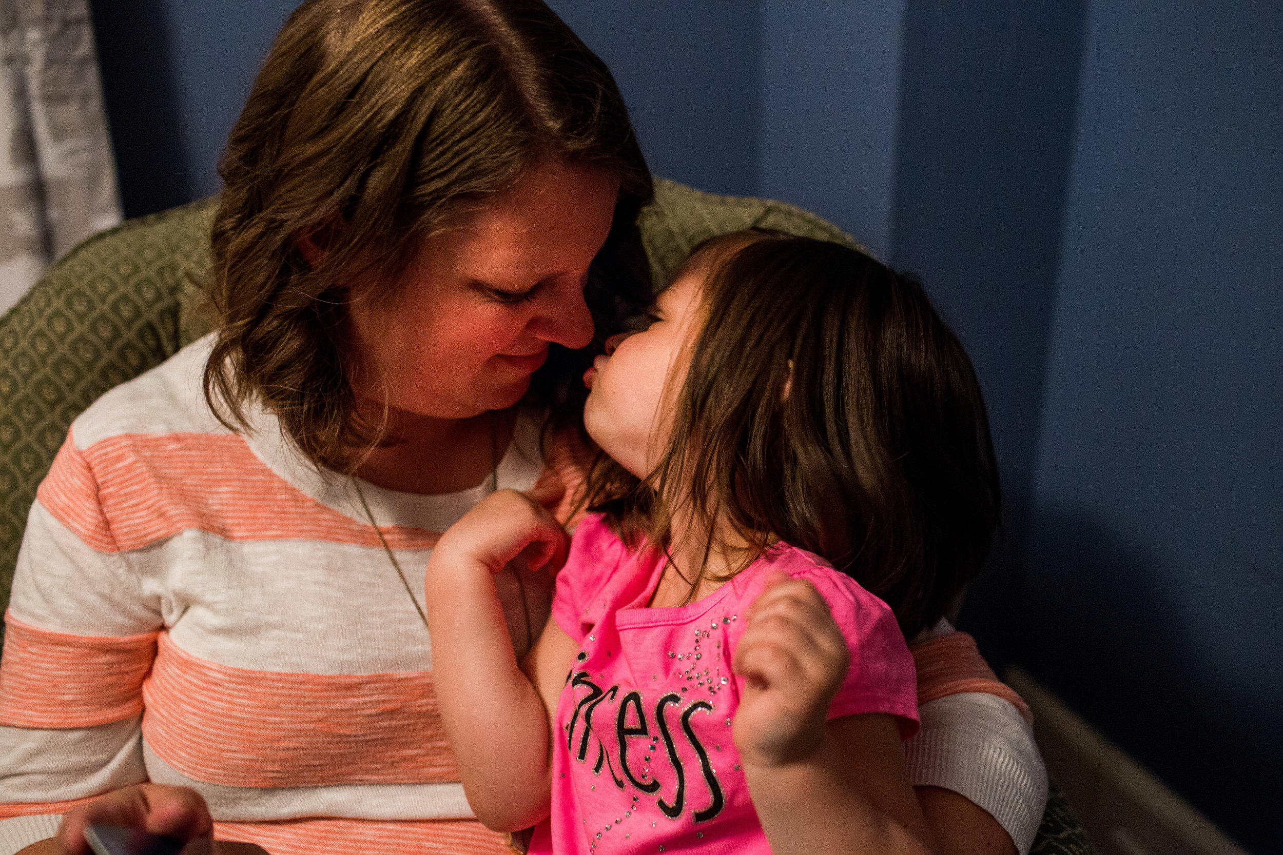 goodnight kisses between mom and daughter