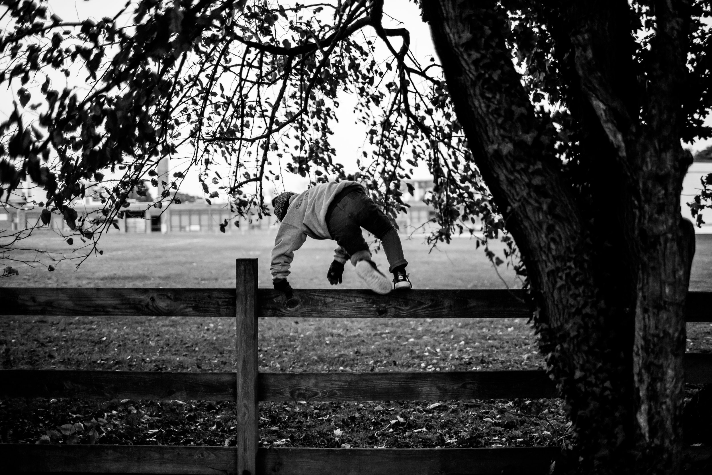 Boy climbing over the fence