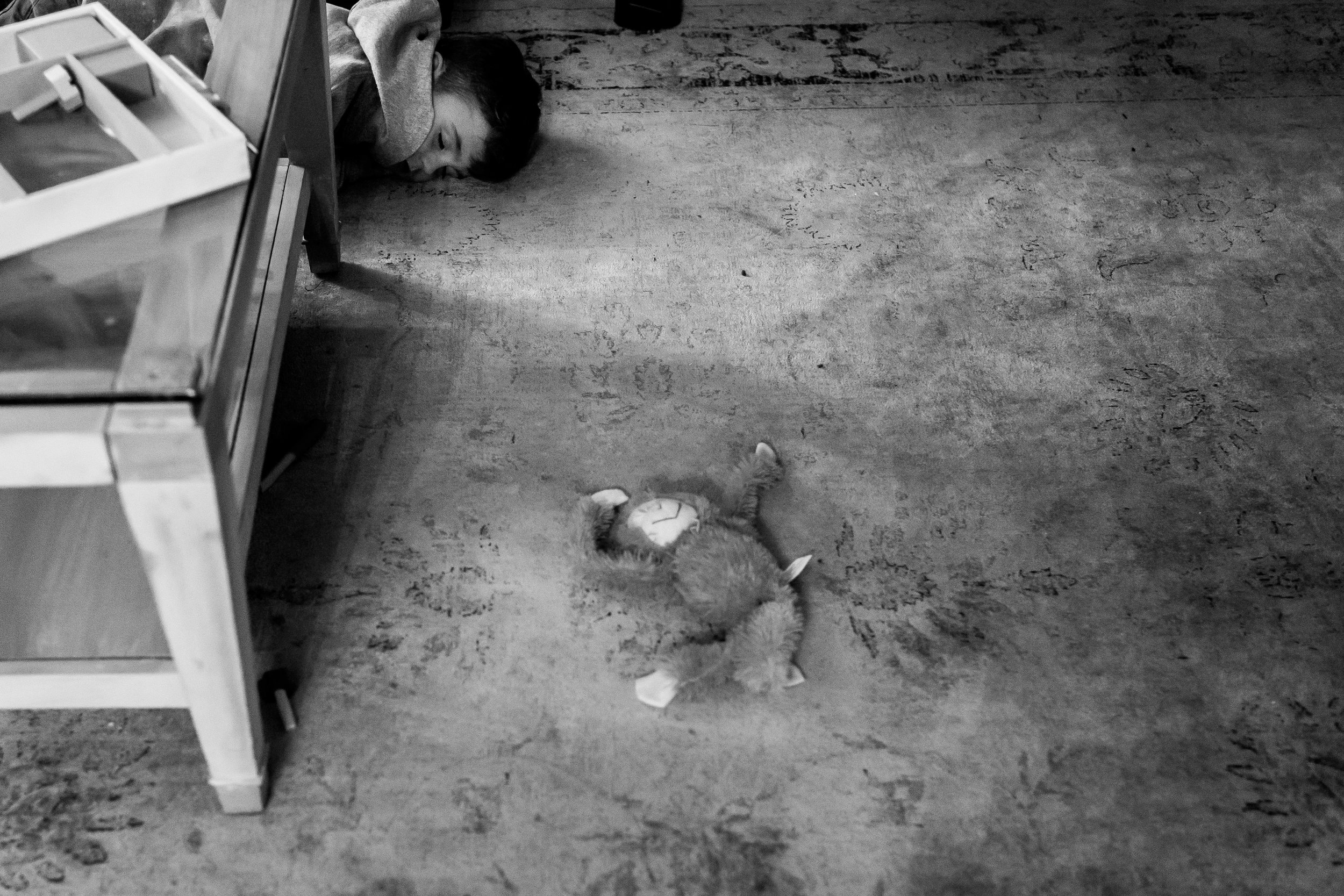 Boy sleeping on the living room floor