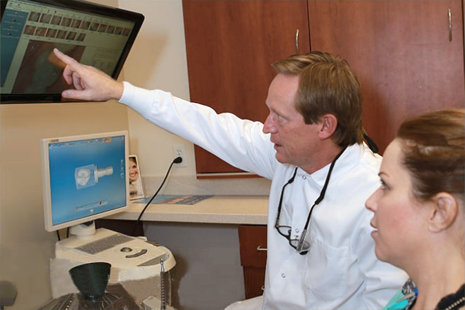Dr. Hekkert pointing at a screen.