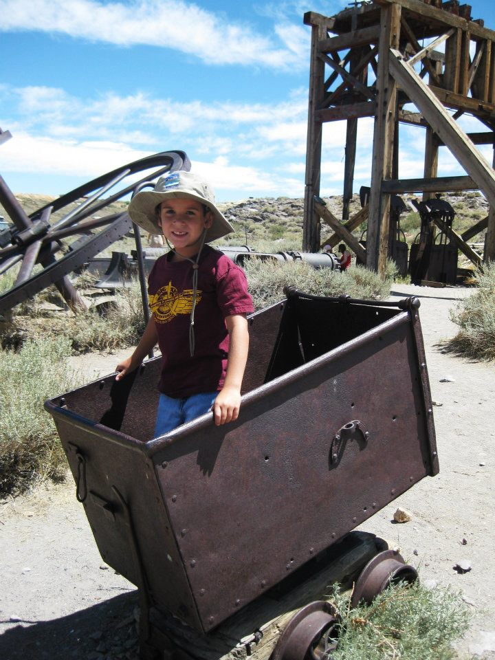 My nephew, Kendall, catching a ride in a gold mining cart at Bodie State Historic Park in California's Eastern Sierra.