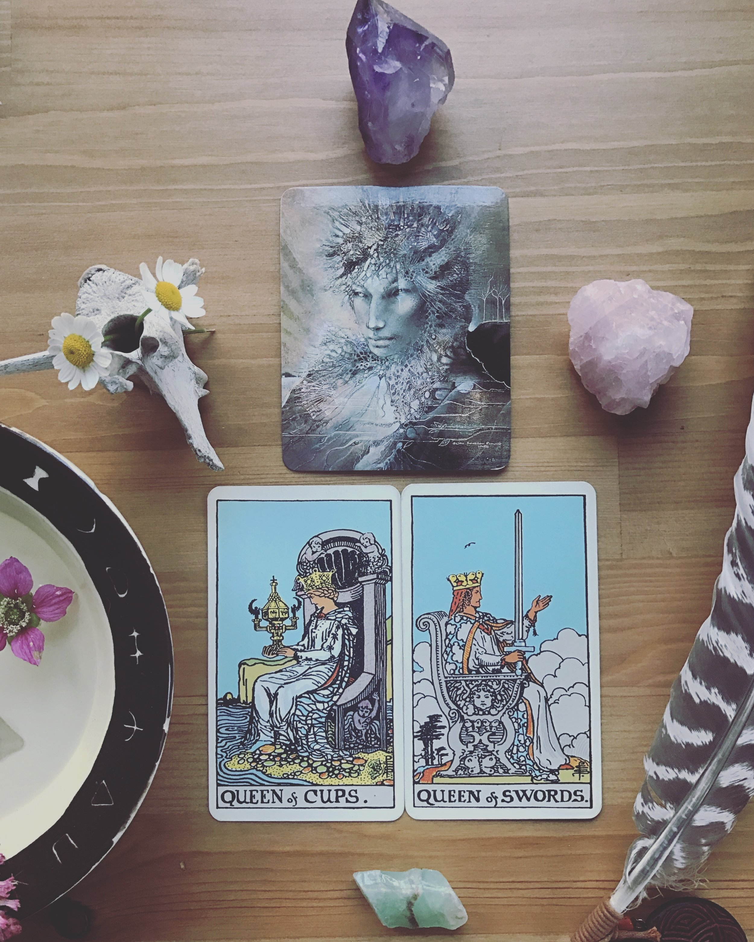 Wishing you all a beautiful new moon in Aries, occurring this evening. Aries is full of passion and fire, able to step into action without second guessing or overthinking. And damnnnnn do some of us need that energy in our lives (me, for one). For those who are in touch with their fiery selves, today's draw brings wisdom in balance for you as well. This morning we are given the queen of cups and the queen of swords, back to back. They may be facing away from one another, but I see these two working together, making sure to have a view of both sides. They have each other's back. Artemis watches from above them, a reminder to be grounded in this wild earth and to bring fuel to their independent natures.   Patriarchal culture (in which tarot was created too) likes to draw a line between logic and emotion, the intuitive and the analytical. But as we are learning more and more, binaries aren't about lines: they are circles and spectrums, cycles and waves. Our intuition obviously aids our analysis and logic can teach us quite a bit about our emotions. These aspects of ourselves interact and inform one another throughout our daily thoughts and expressions. They are not in separate boxes.  As our energy shifts with the seasons and the planets, let us utilize both our logic and our intuition. This combination grants us some fierce, feeling, intelligent, and wild energy. Let us channel it into our creativity. Allow it to guide our actions. May we revel in ourselves, one another, and the glory of being alive and able to act, able to create, able to analyze and think. Let us follow our intuition into action and allow our wit to inform us along the way. Let us be active in our connection to our bodies, our planet, and our compassion for each other and the fate of this world.  Let us be centered, have one another's back, and continue to allow all four elements be present in our creative endeavors, in the actions we take, in the love that we make, and the connections we form.  Lov