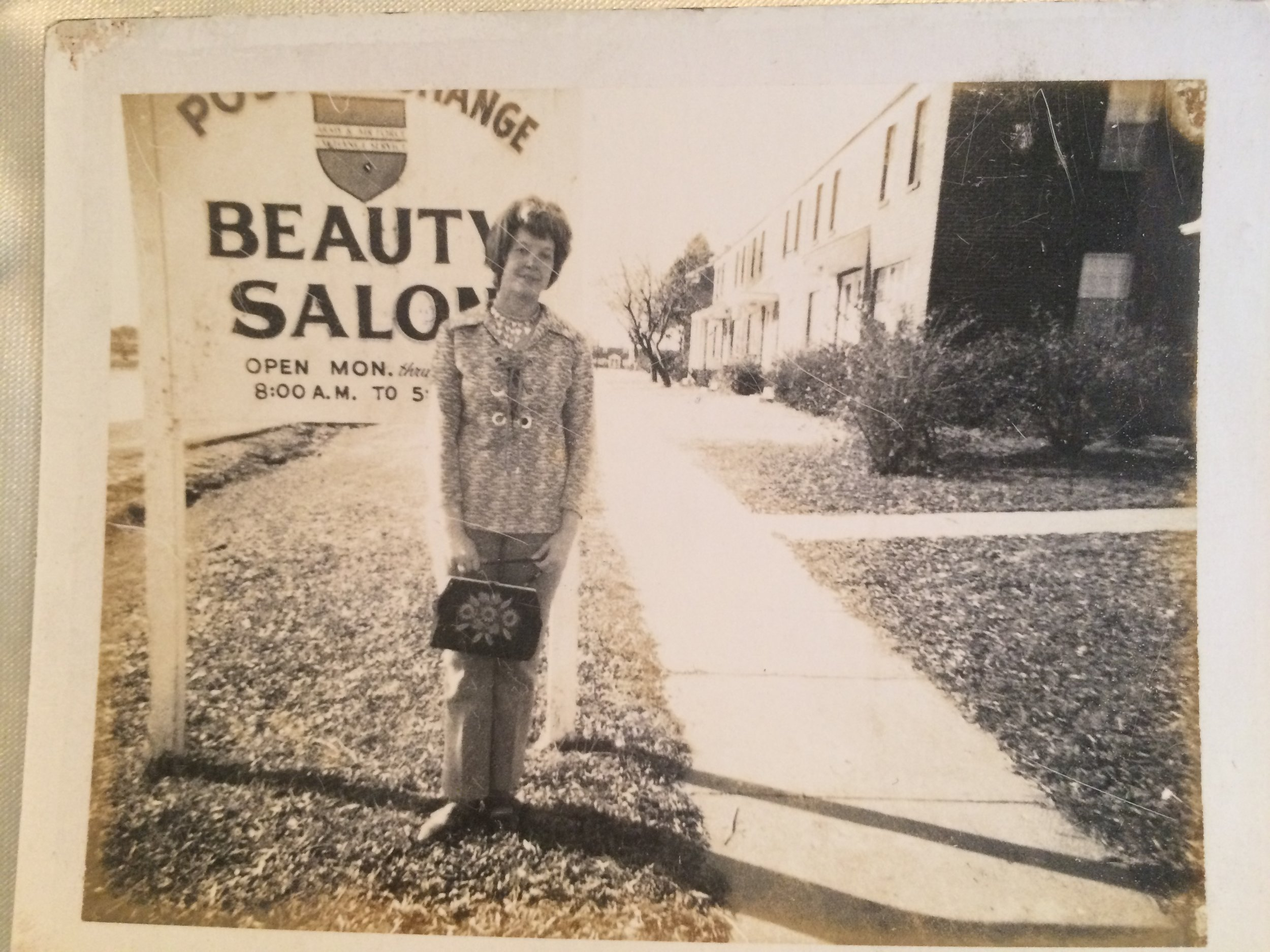 Mom beside one of her beauty shops at Fort Campbell.