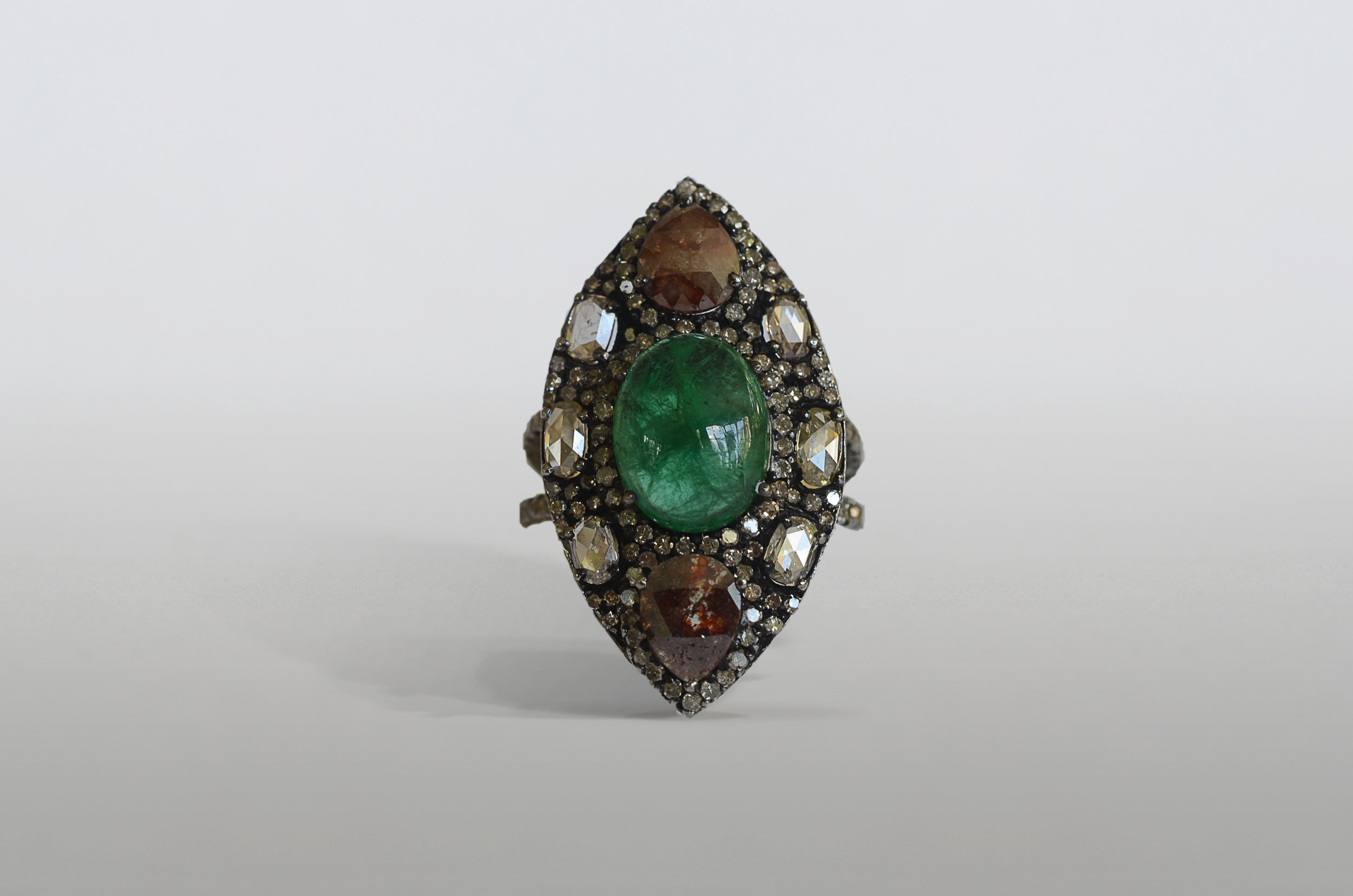 Approximately 4.0 Carat Cabochon Emerald with 3.43 Carat Brown and White Diamonds set in Sterling Silver and 18kt Yellow Gold