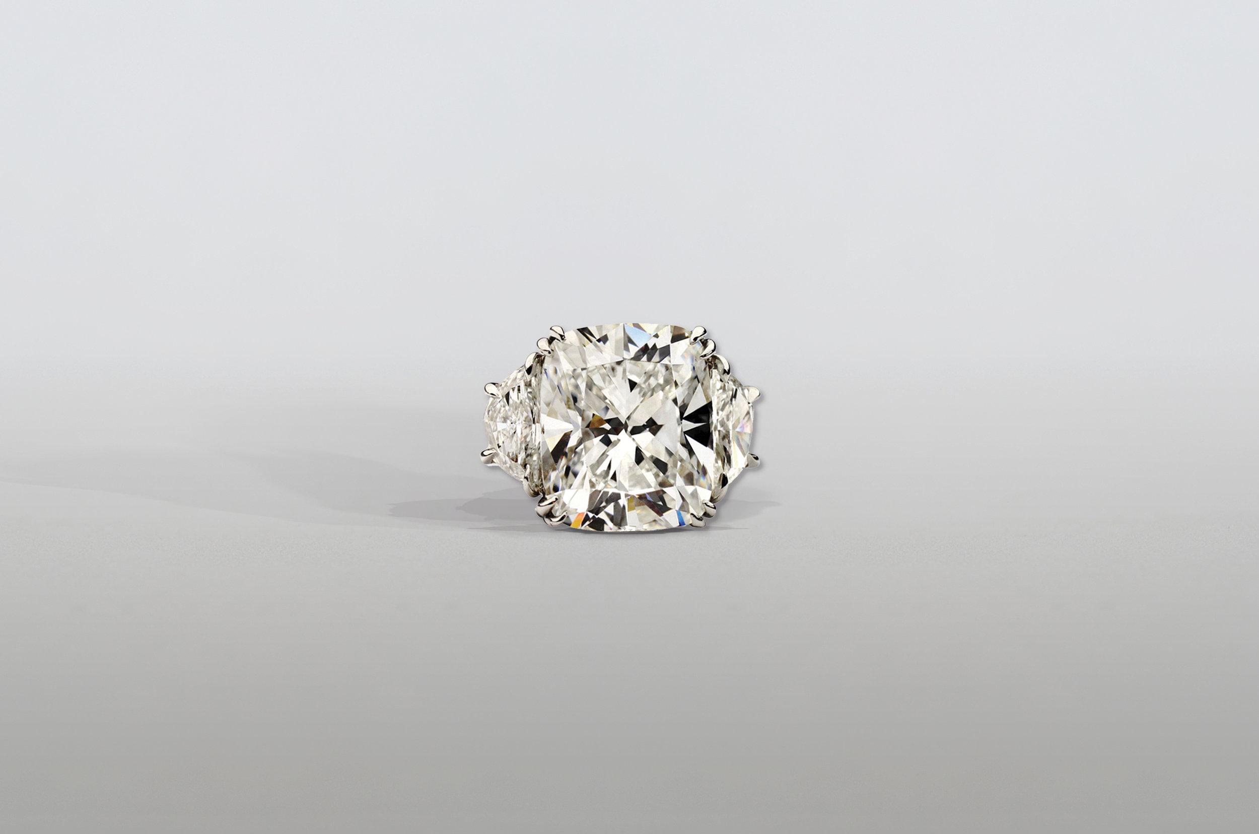 6 Carat Radiant Cushion Diamond Ring with Shield Diamonds set in Platinum