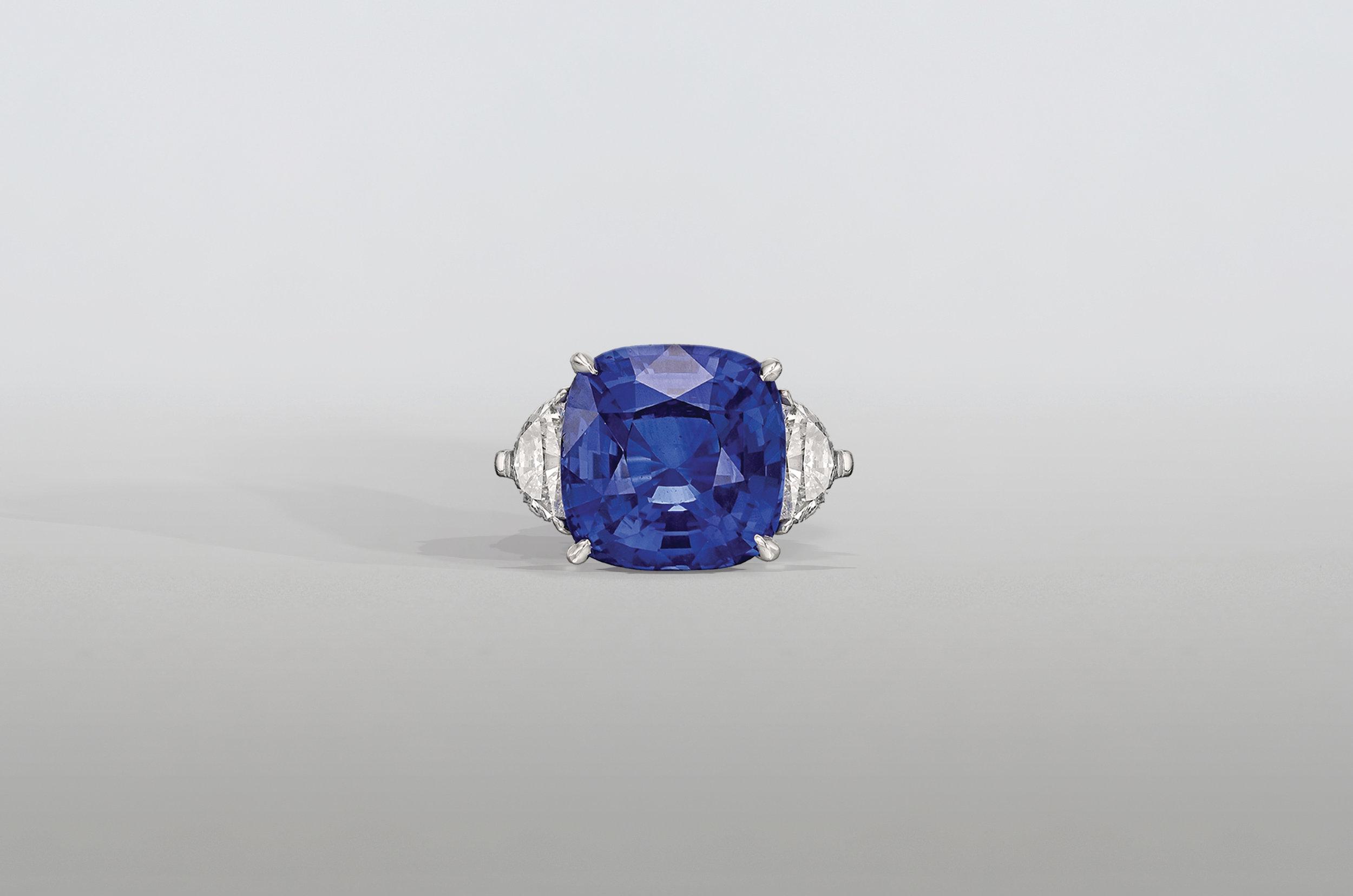 8.5 Carat Cushion Sapphire Ring with Trillion Diamonds set in Platinum
