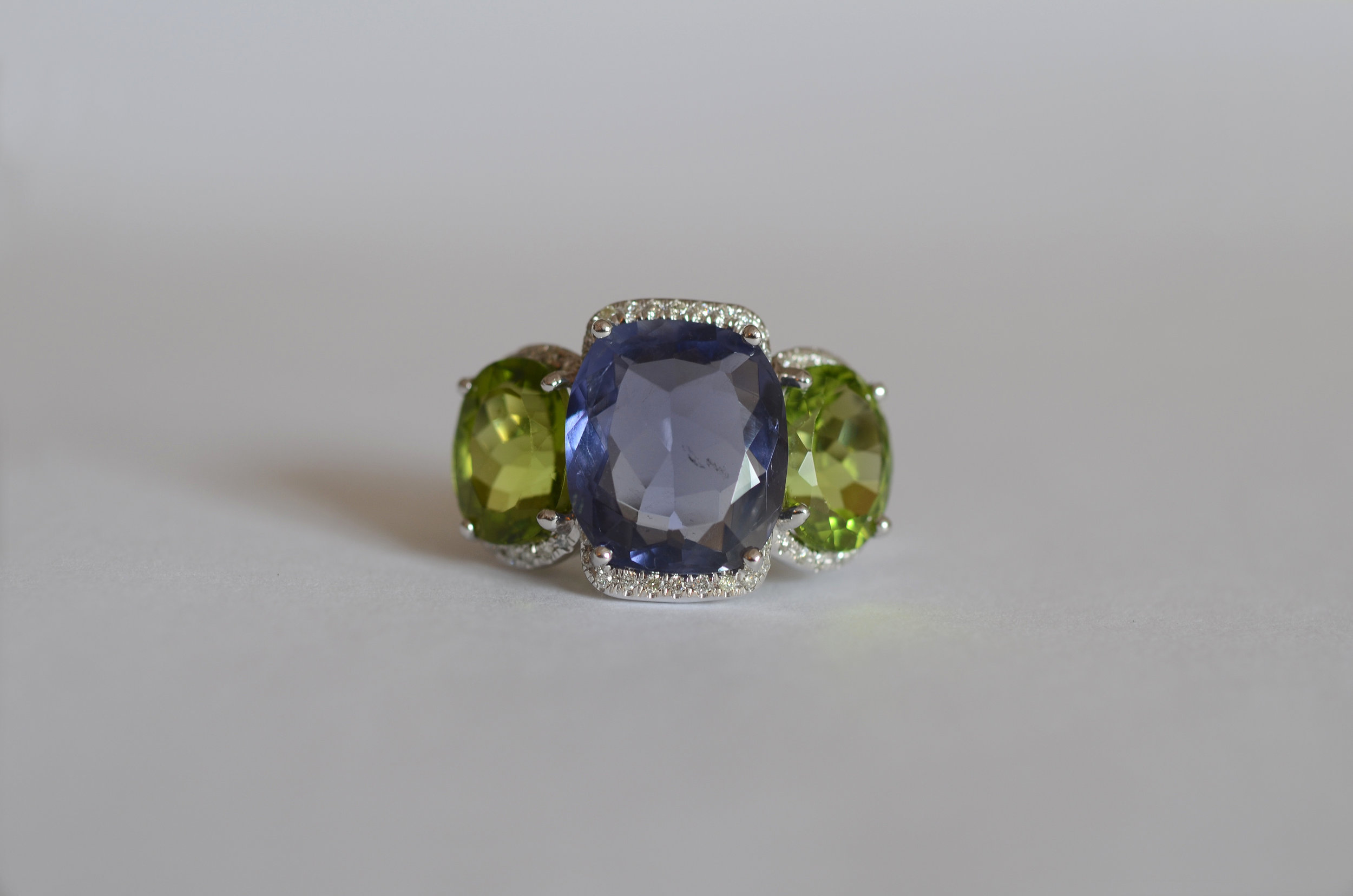 7.47 Carat Iolite and 9.10 Carat Peridot Ring accented with .30 Carat Diamonds set in 18kt White Gold