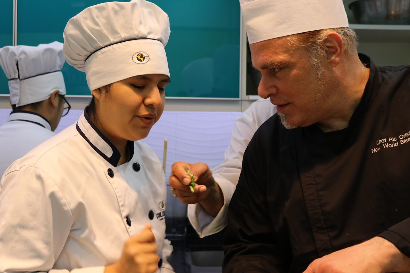 """Teaching a young student to taste her cooking at the Le Cordon Bleu cooking school in Lima, Peru."" – Ric Orlando"