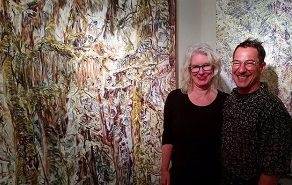 "Jen Dragon (left) with fellow SUNY Purchase alum Dion Yannatos, in front of his painting ""Cascades,"" on view at Cross Contemporary Art Gallery in May 2016."