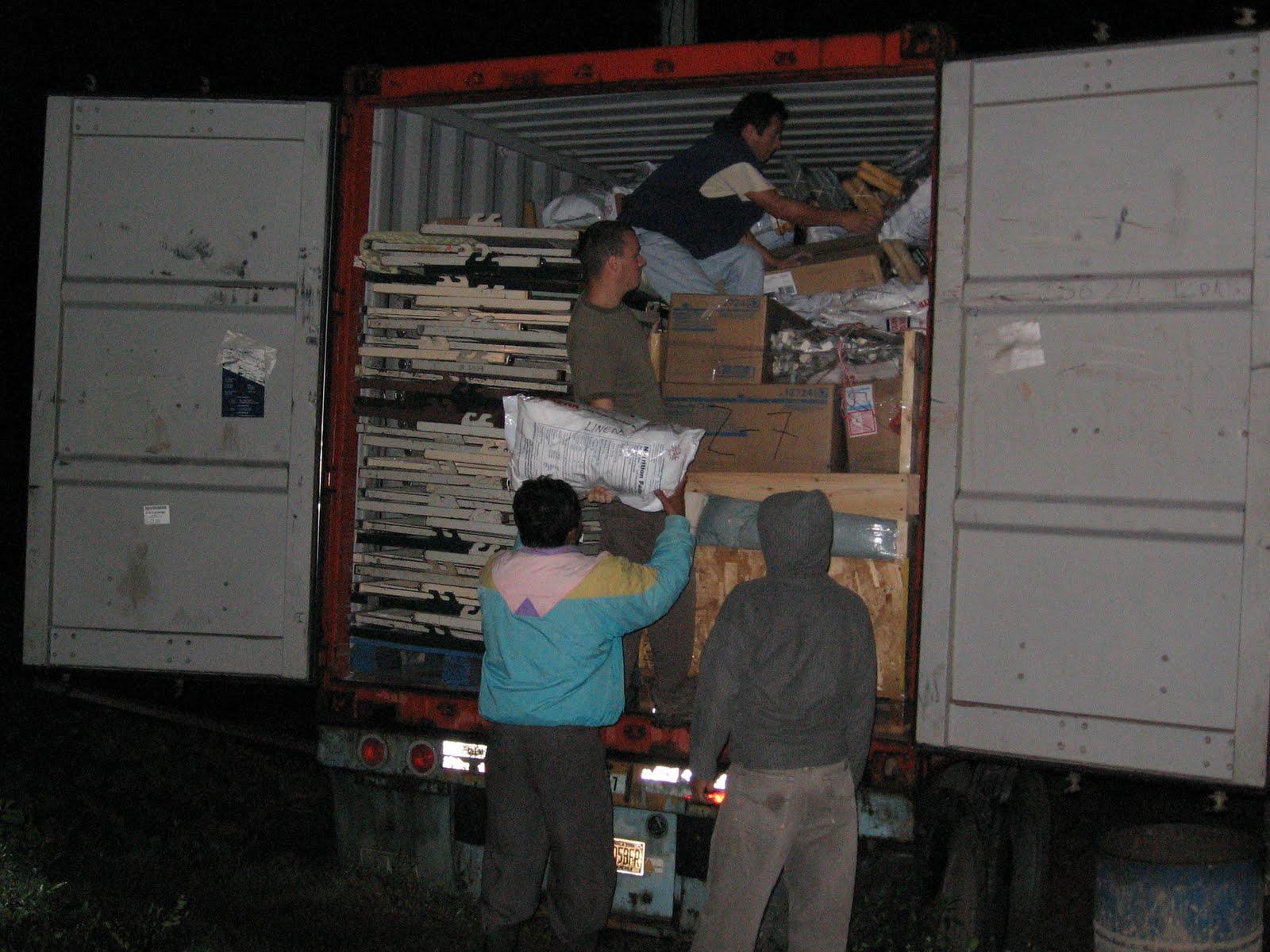 BVC Coban 2009 Pat Deering unloading container.jpg