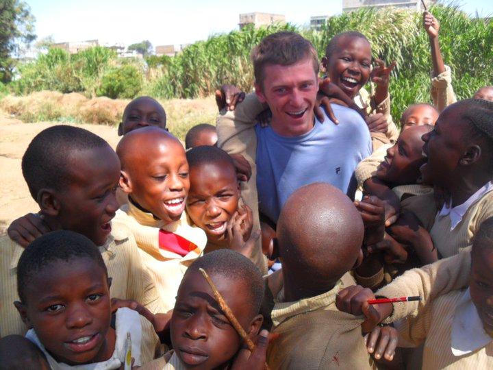 BVC Nairobi 2010 Greg Sullivan with kids on back.jpg
