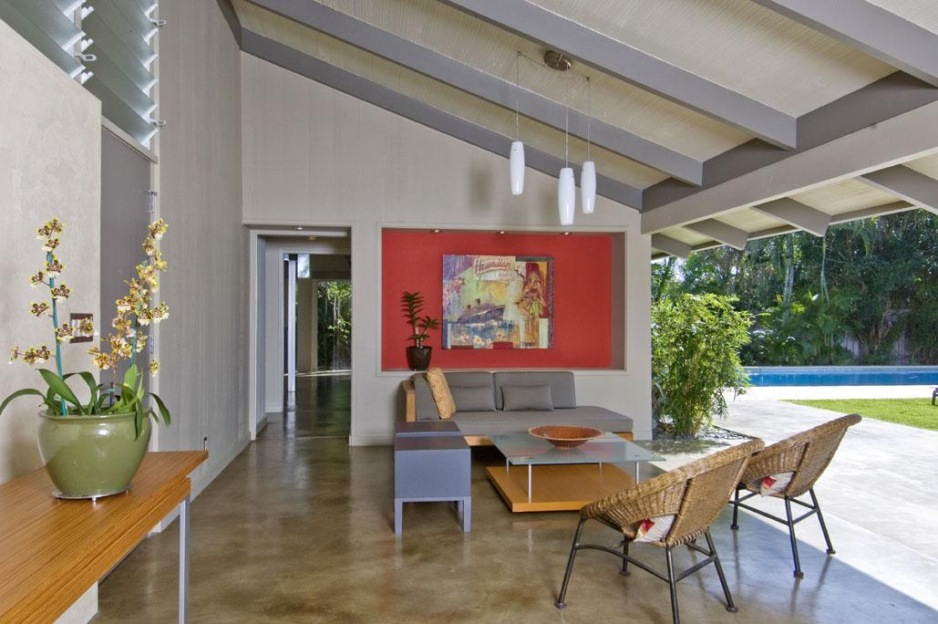 Walking through the front door leads directly into this covered lanai area—true indoor/outdoor living. PHOTO BY: HAL LUM