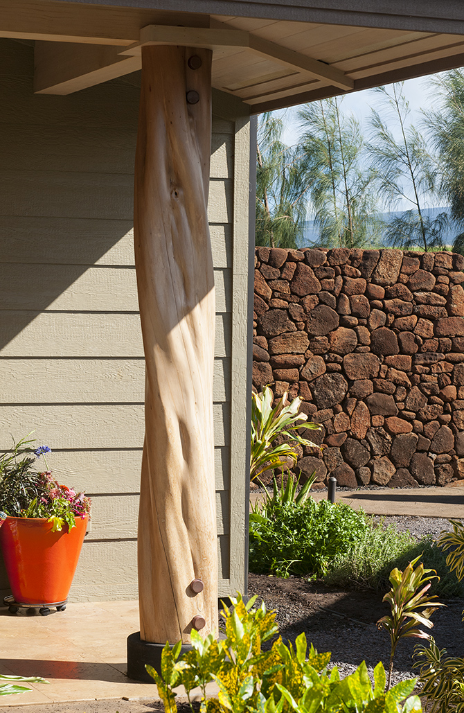 Local natural materials as used when possible. Local, FSC Ohia poles and lava rocks for walls are shown here.