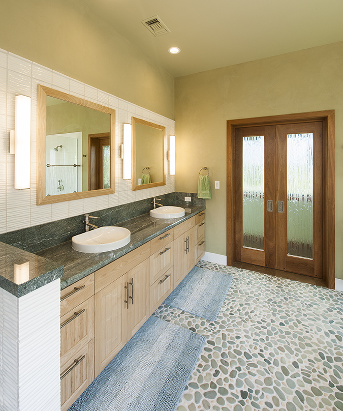Natural Materials include: Local FSC wood for cabinets, pebble flooring, natural clay plaster on walls.