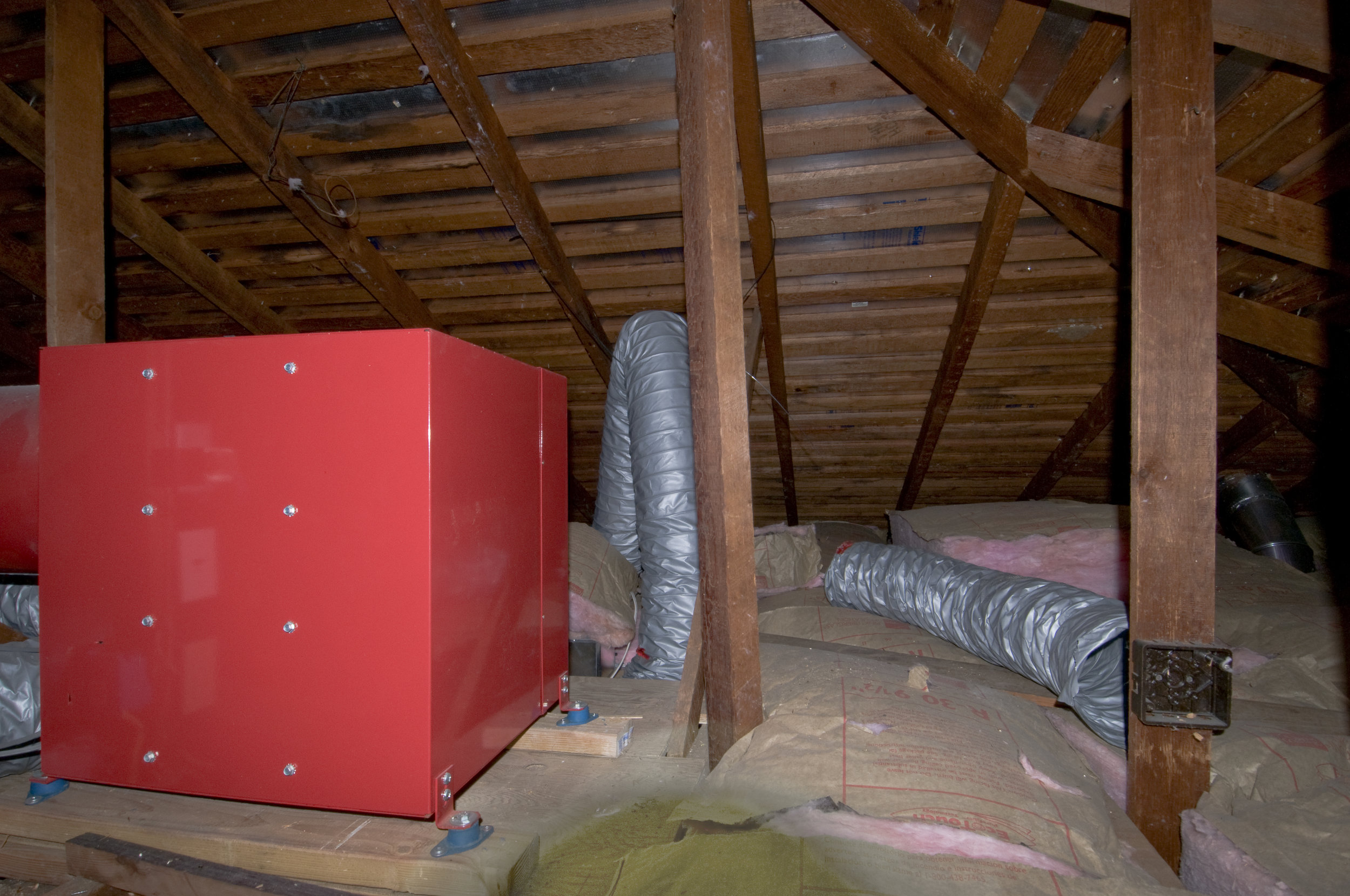Whole House Fan in attic to provide mechanical assistance to this naturally ventilated house with no air conditioning