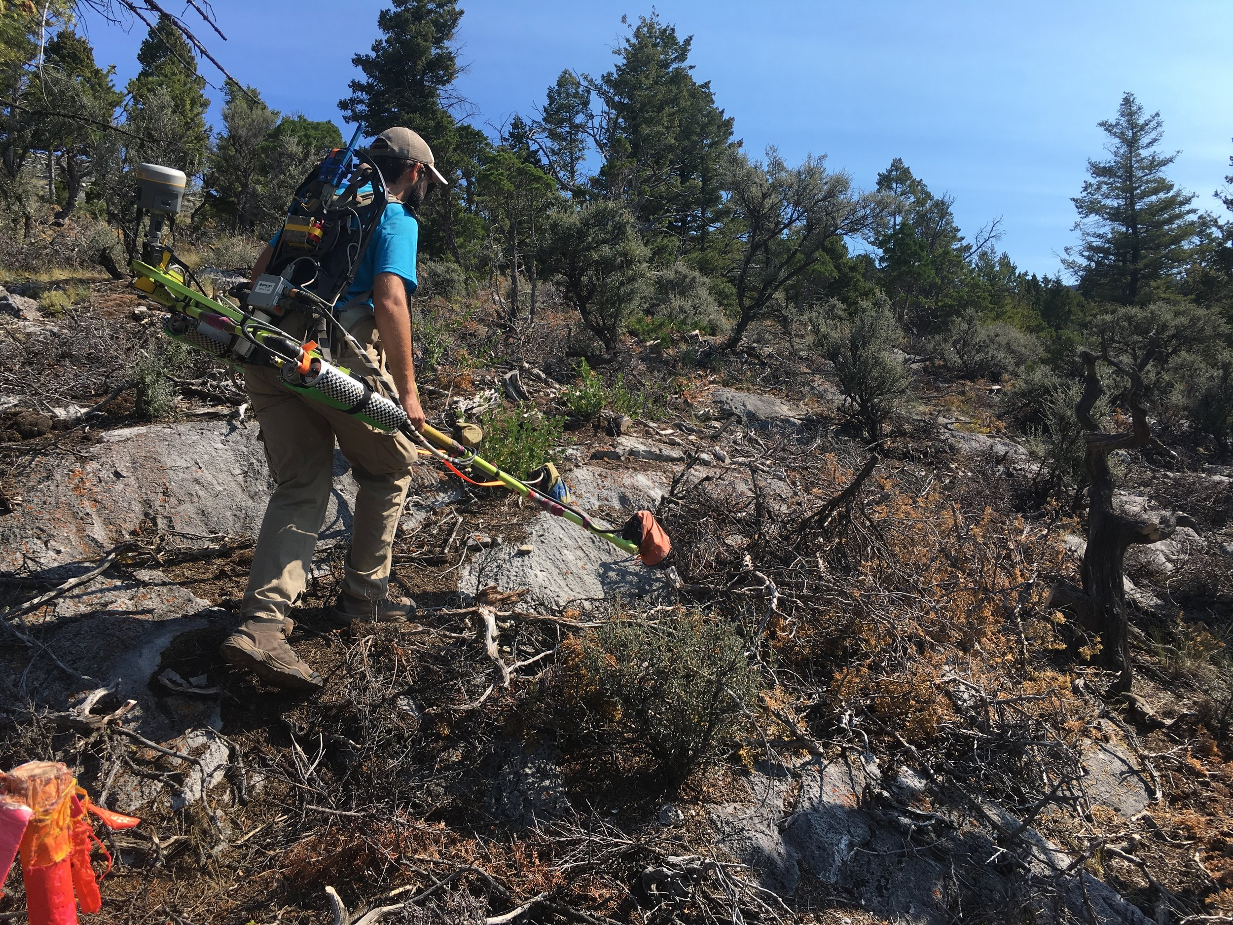 Scott conducts a magnetic survey in the rugged terrain of the Limestone Hills, near Townsend, MT to locate UXO.