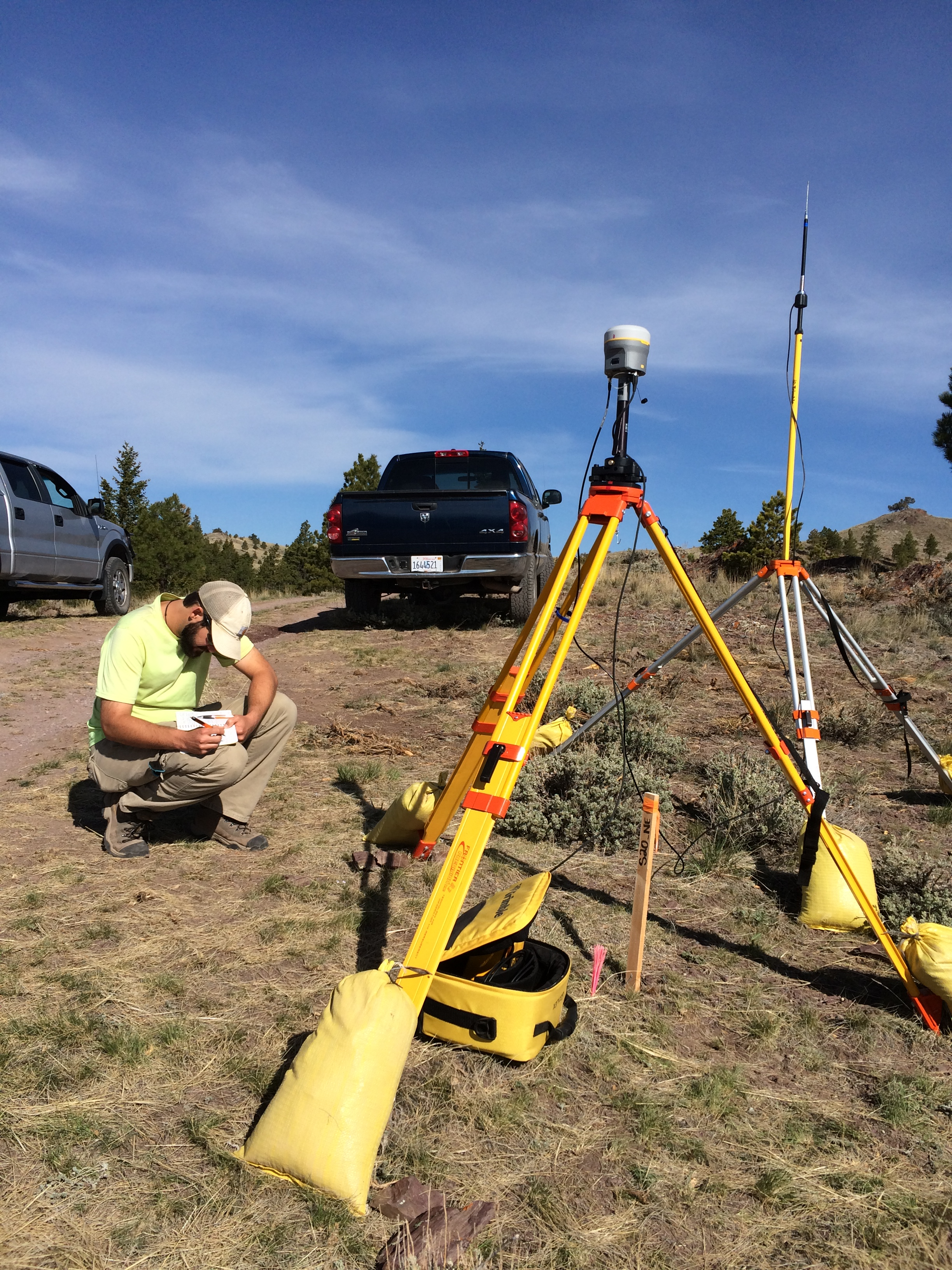 Scott sets up the Trimble R10 base station and repeater for accurate GPS position control.