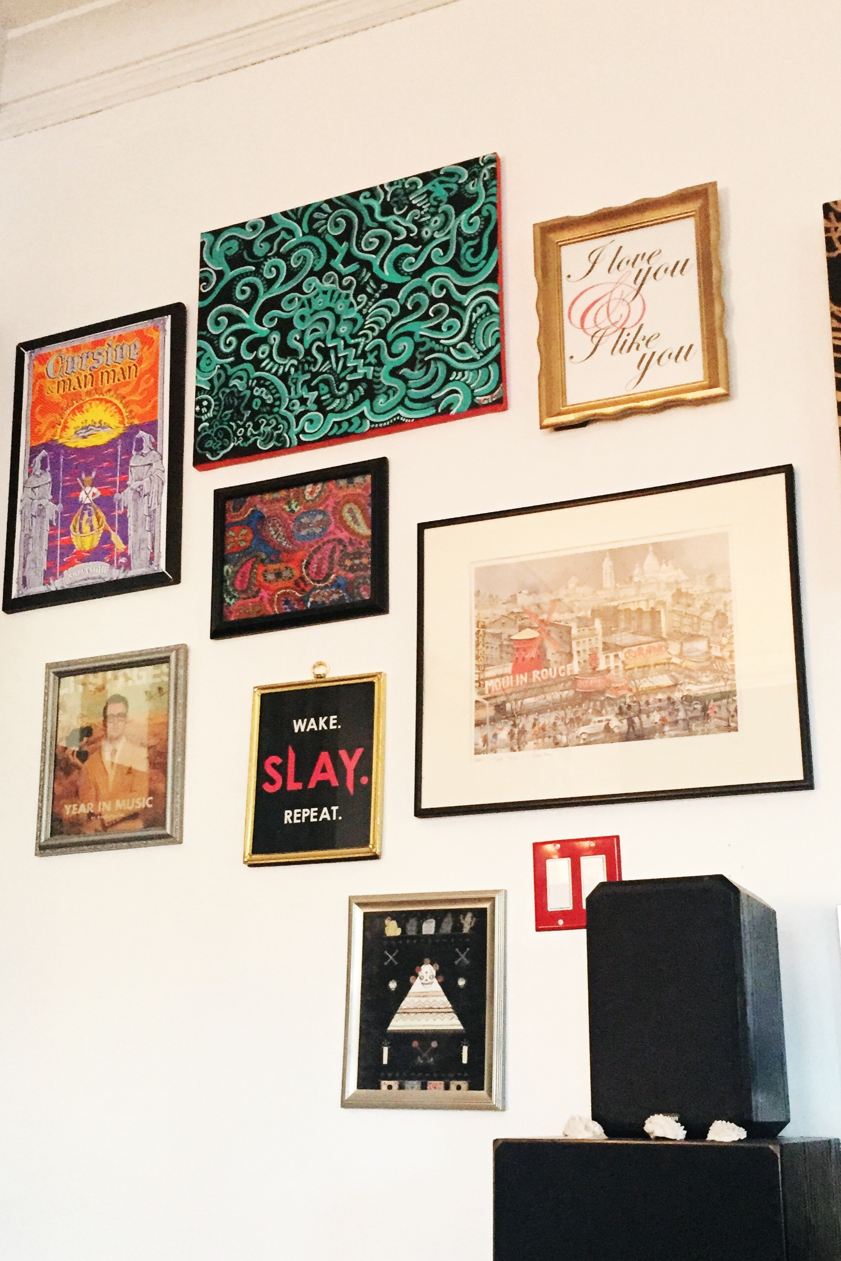 Here is a closeup of my gallery wall. I went with a mixture of frame styles and colors. Also don't Jeni's prints look great?!