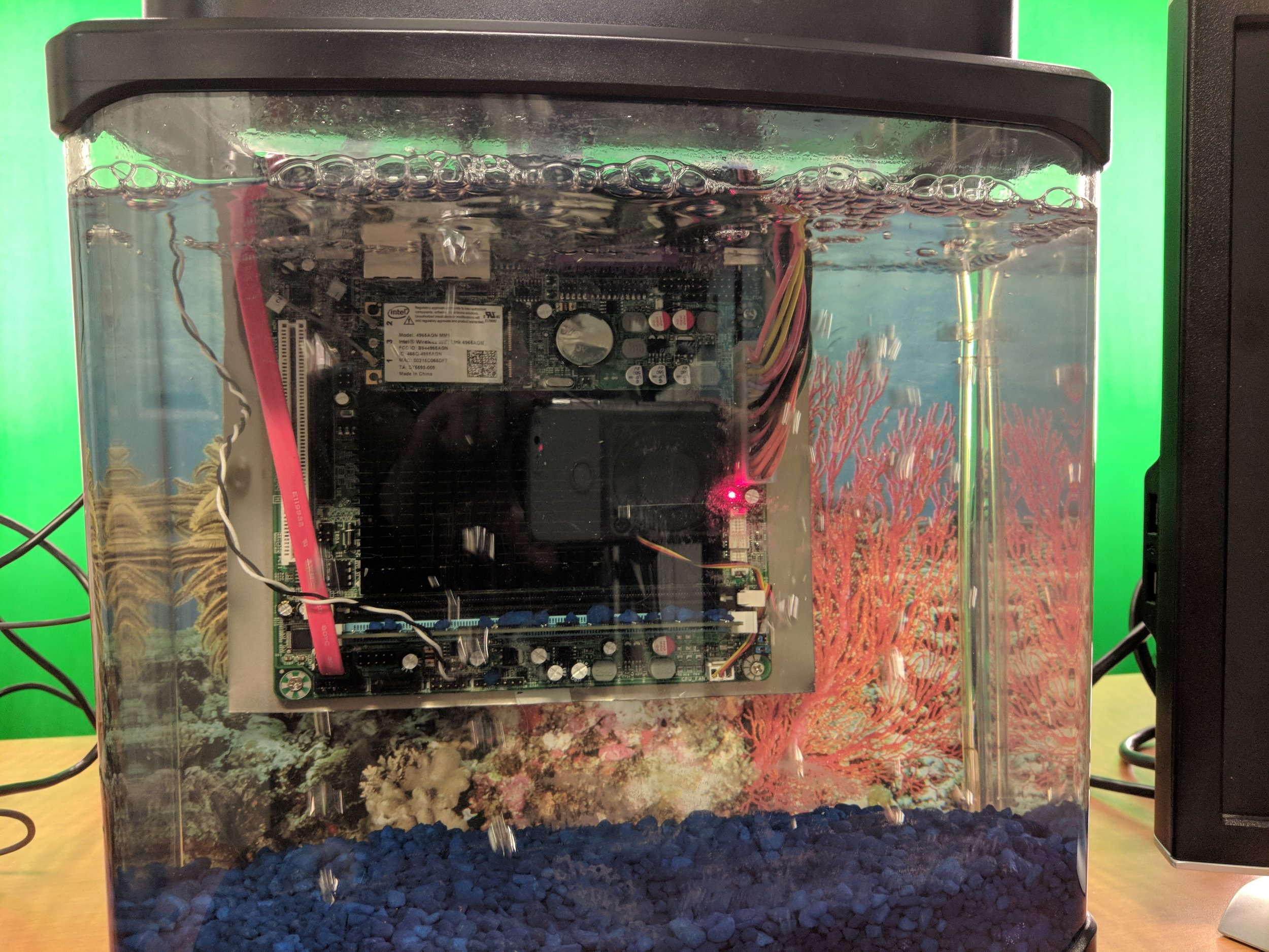 Brad took his computer and put it in a fish tank full of baby oil. It works! The oil helps dissipate the heat, although this was just for fun. Obviously, the computer also ran fine when it was not in baby oil.