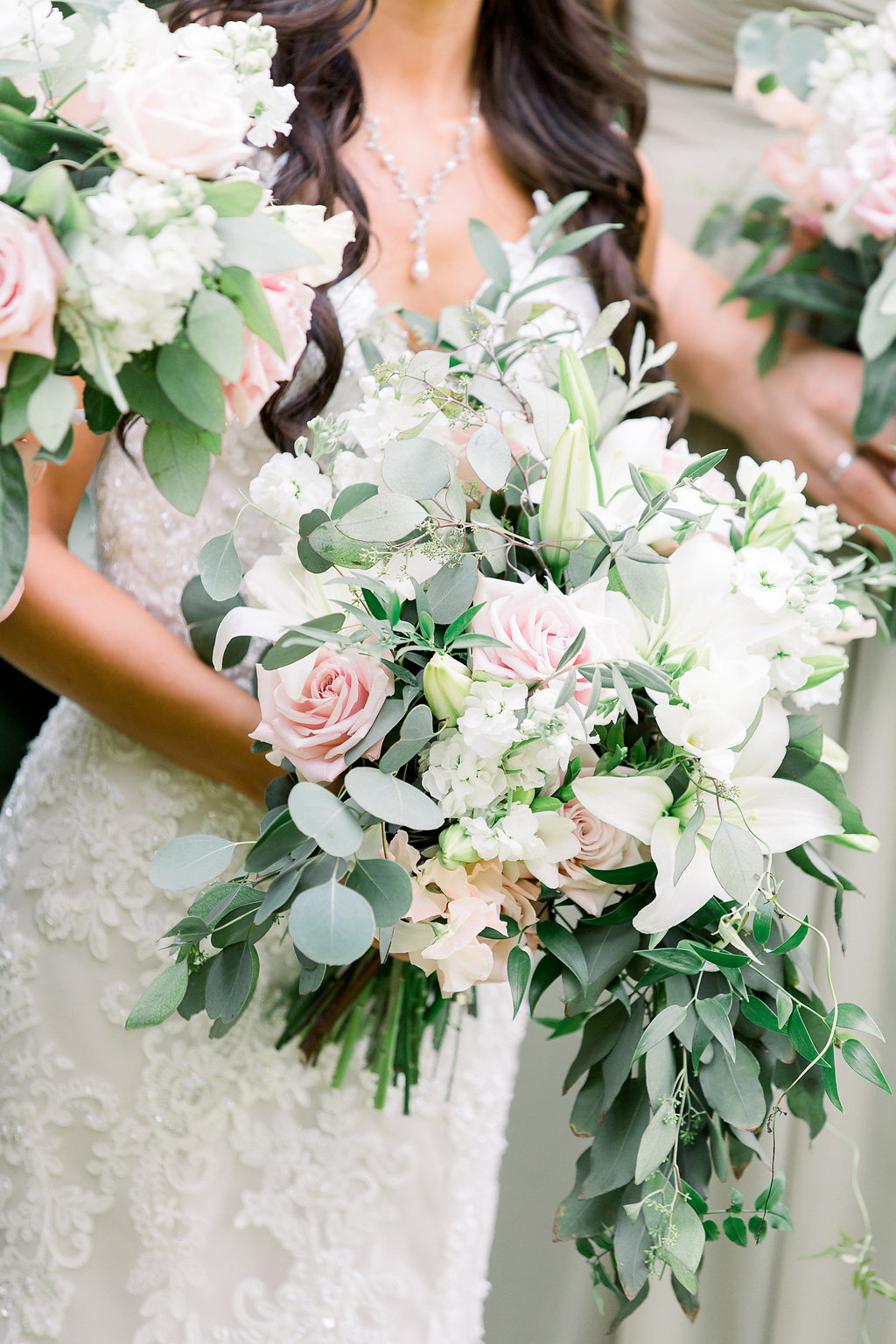 Bridal Bouquet in soft Blush and White with lots of lush foliage.