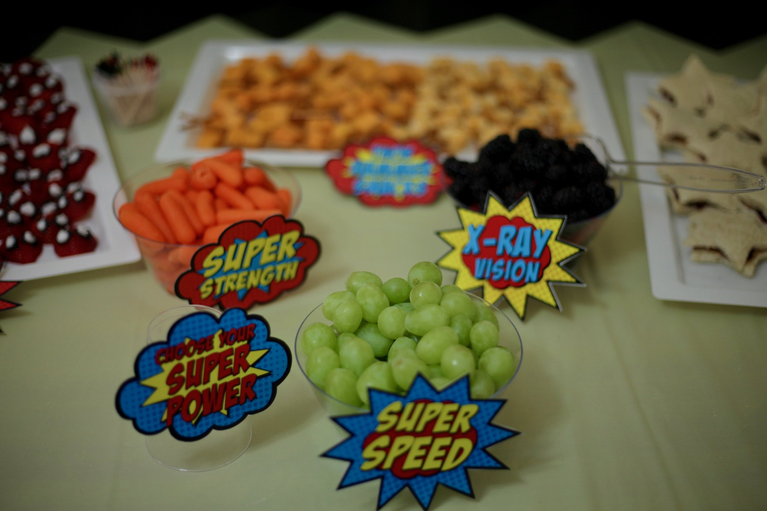 I added a 'choose your super power' sign and different super powers to fruit and veggie bowls.