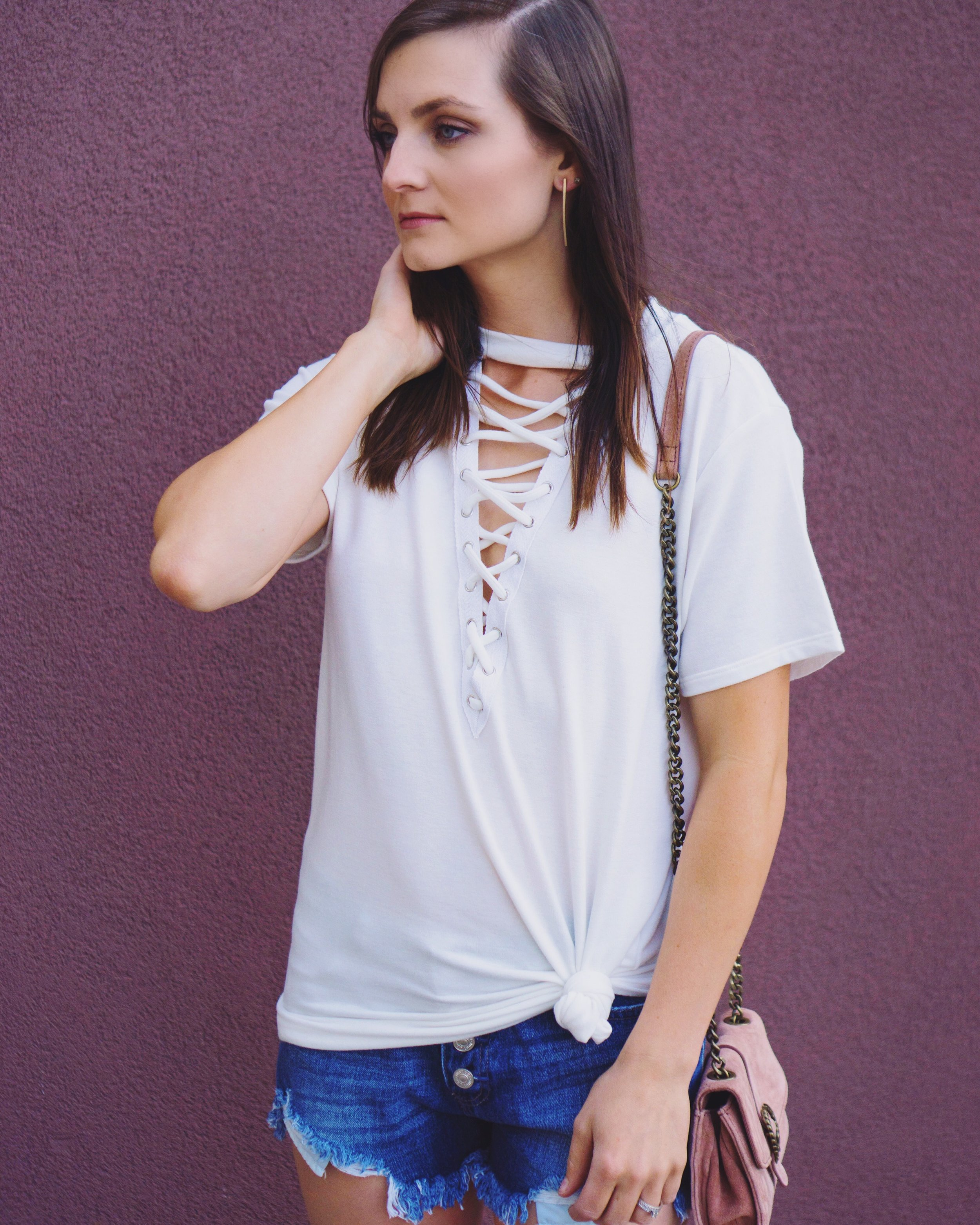 "<img src =""style-collective-fearless-friday-award.jpg"" alt=""fashion-lace-up-tee-distressed-denim-cut-offs-style-collective-fearless-award"">"