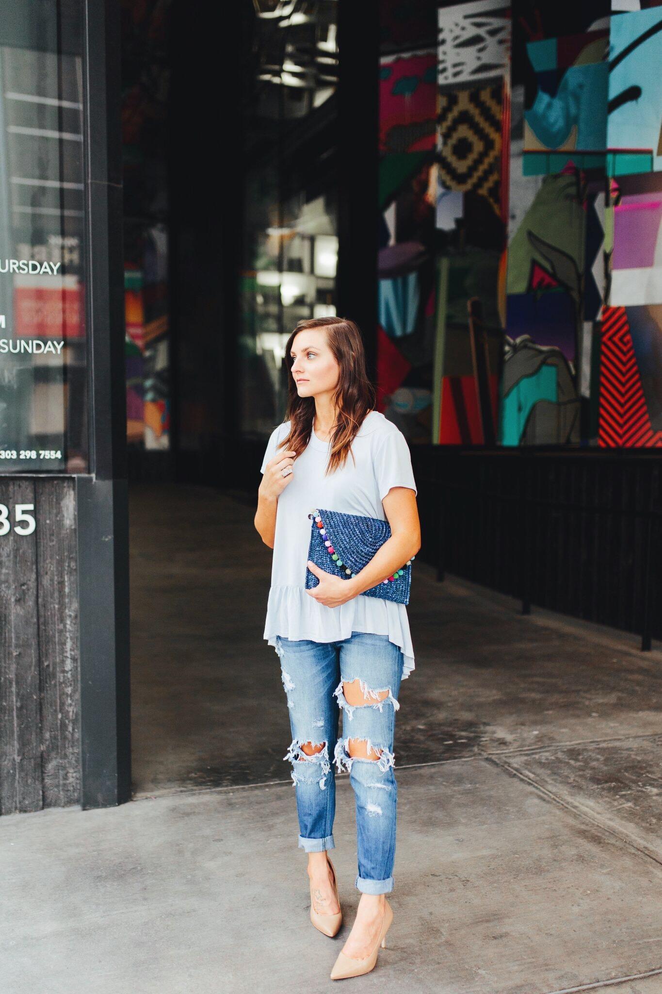 "<img src =""how-to-wear-boyfriend-jeans.jpg"" alt = ""fashion-blogger-teddybearsandlipstick-in-downtown-denver-holding-a-blue-clutch-with-colorful-pompoms-wearing-boyfriend-jenas-sam-edelman-hazel-pumps-a-blue-peplum-top"">"