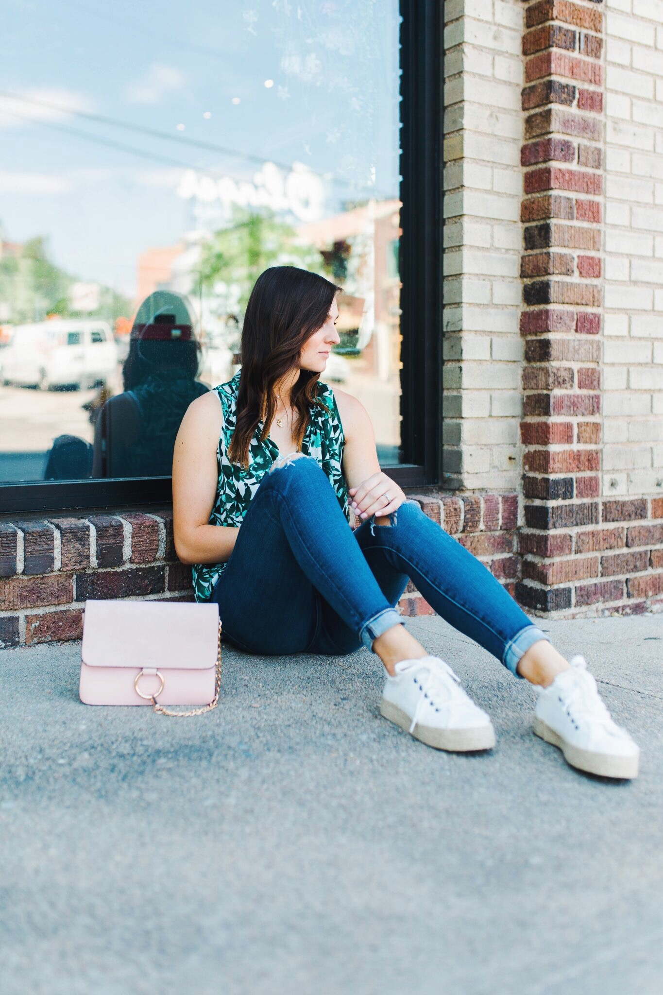 """<img src= five-summer-pieces-to-have-in-your-closet.jpg"""" alt= """"denver-fashion-blogger-sitting-in-front-of-a-store-wearing-summer-essential-pieces-to-have-in-your-closet-bold-patterned-tank-top-blouse-white-espadrille-platform-sneakers-ag-adriano-goldschmied-11-year-swapmeet-distressed-skinny-jeans-light-pink-chloe-faye-dupe-bag"""">"""