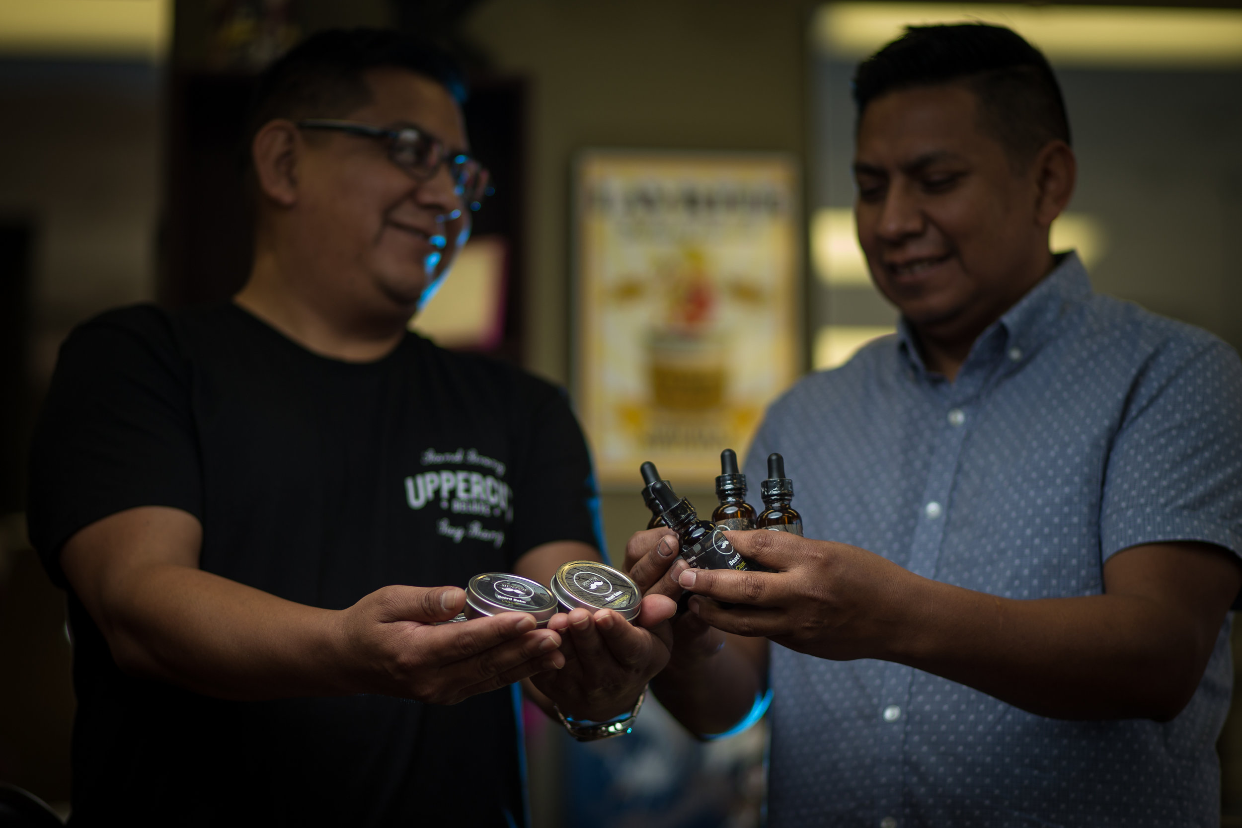 jo and carlos holding bals oils see oils.jpg
