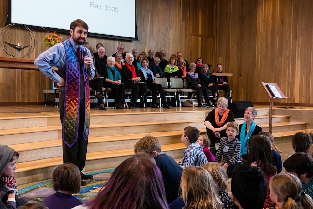 Rev. Scott Rudolph tells the children a story about love.