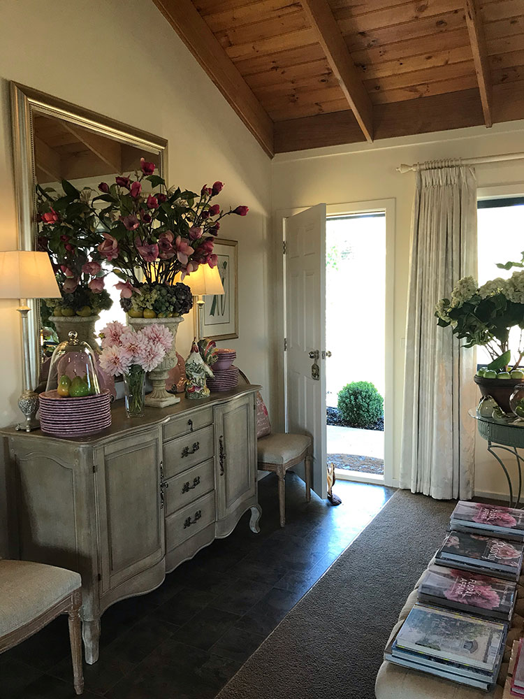 The welcome is warm and inviting with pink flowers from the garden