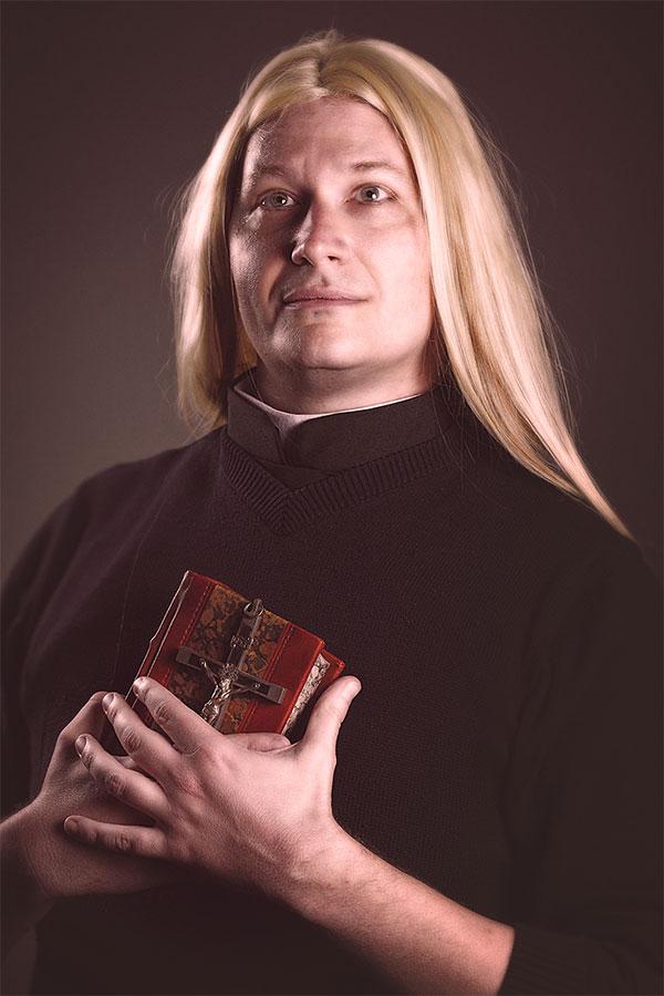 Ben Hardie as Father Heath Rinaldi