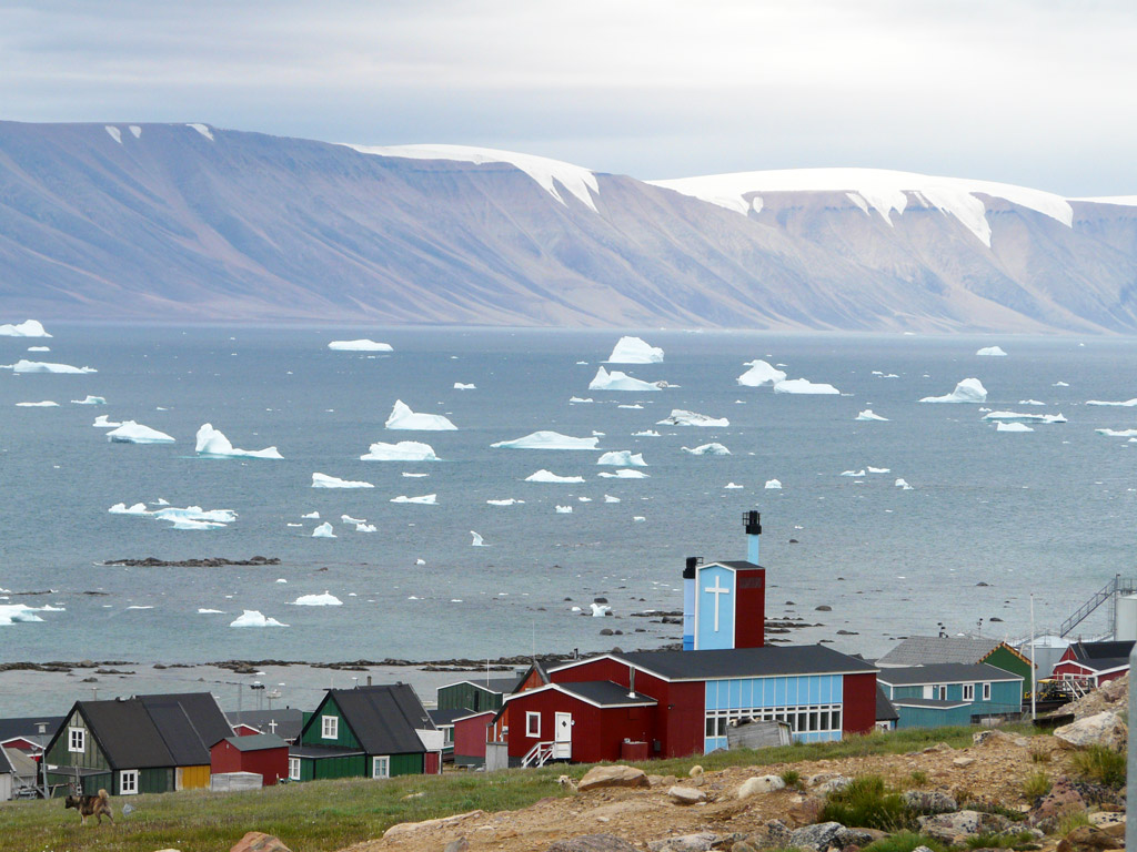 Qaanaaq Church and town in the surreal light of the midnight sun