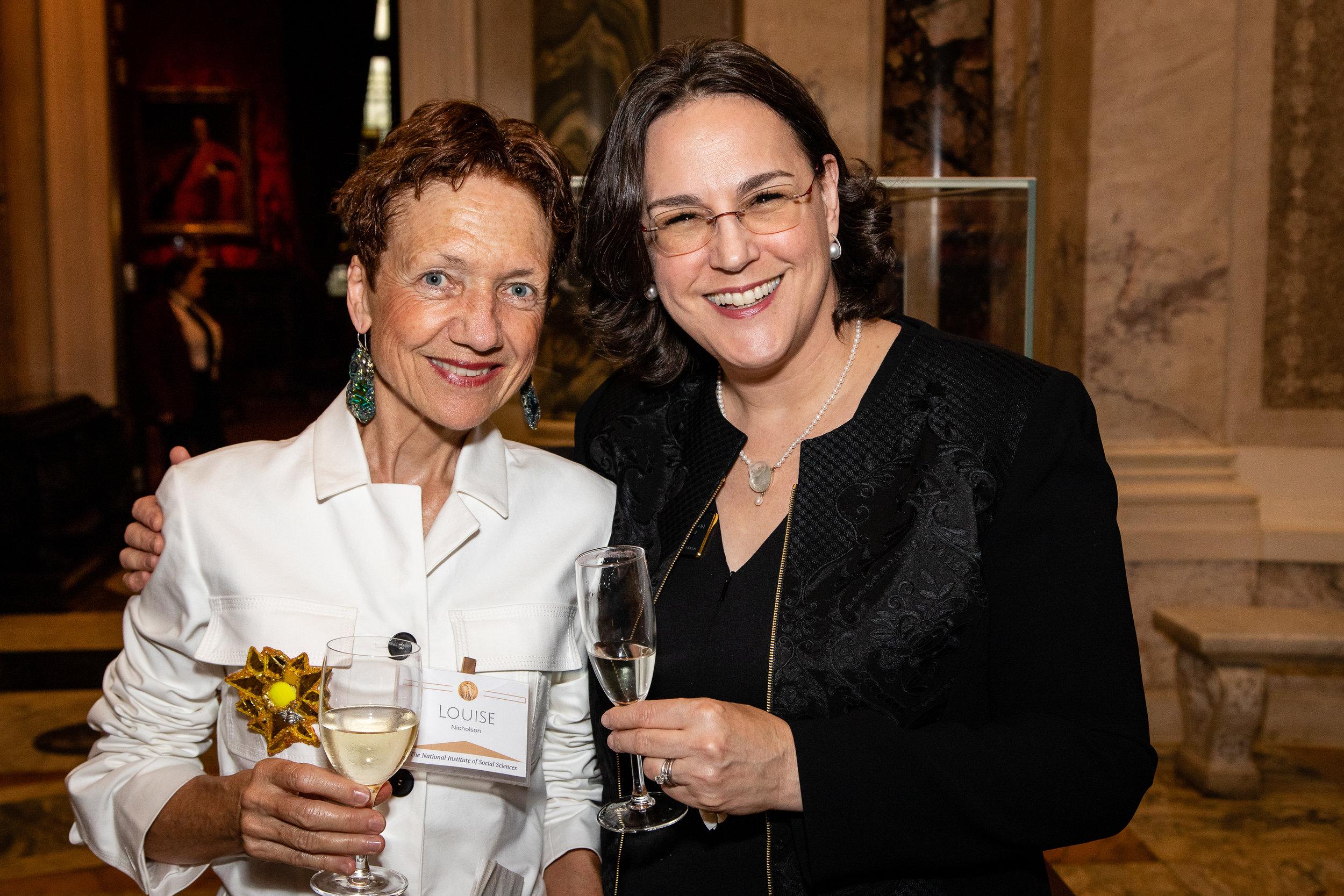 Louise Nicholson, Angela Cason