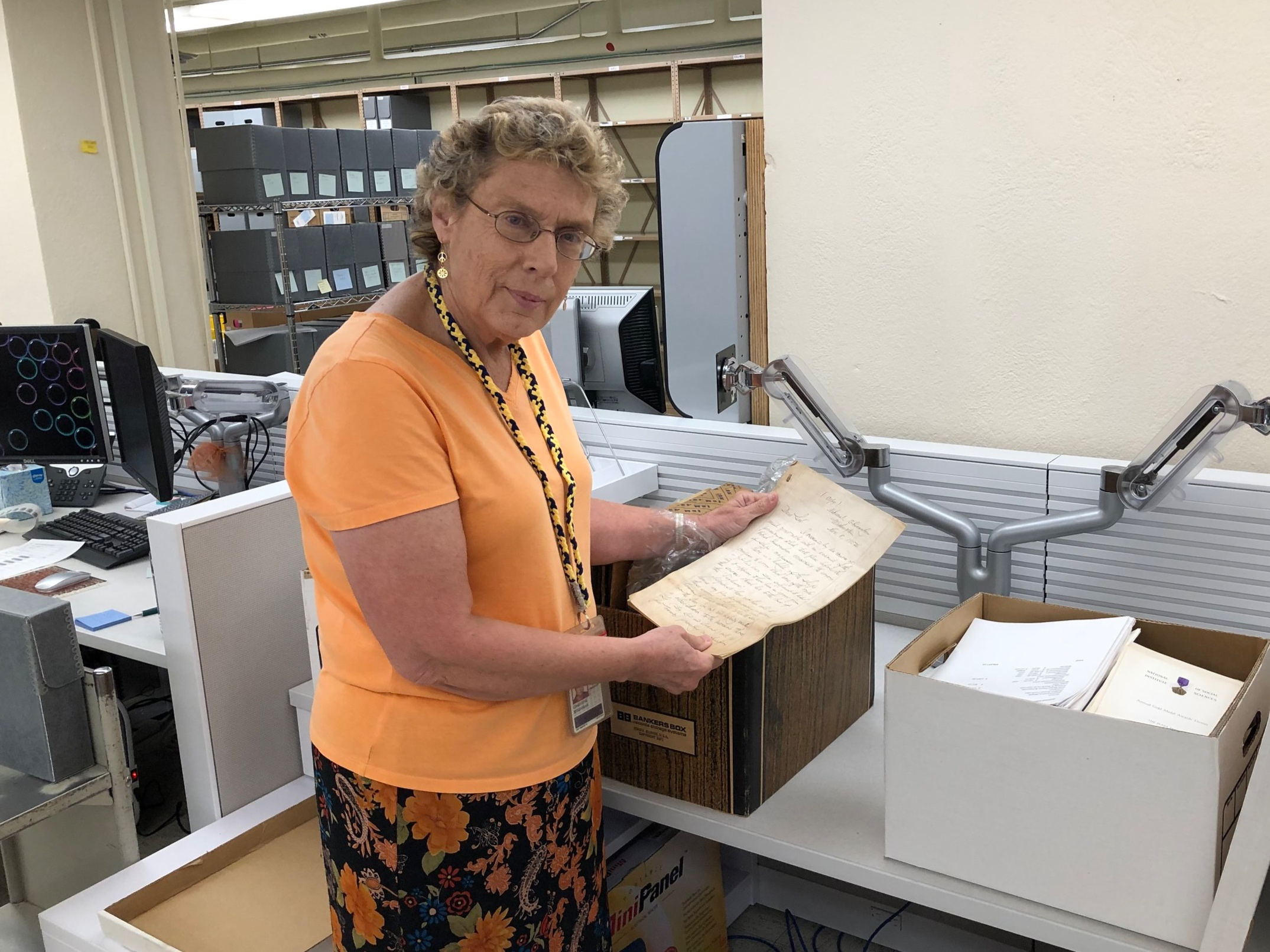 Christine Weideman, the Carrie S. Beinecke Director of Manuscripts and Archives, examines a piece of early correspondence from the National Institute's donation to Yale.