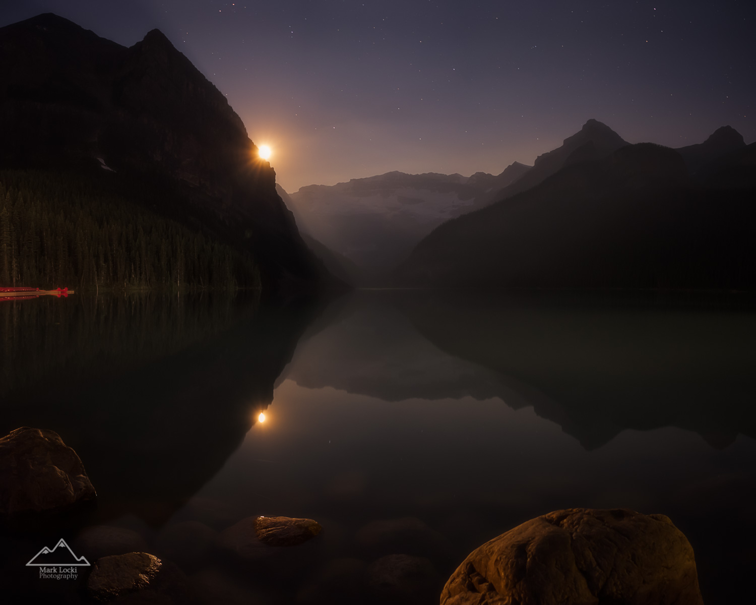 Luminous Lake Louise: I spent an evening around Lake Louise hoping to see a bit of the Milky Way, but figured the moon would probably be too bright on that night. Not knowing what I would come up with, I went out for some night photography anyways. After spending an hour or two around the Lake, the Moon finally peaked out from behind The Mitre. A little bit of smoke from distant wildfires provided a bit of a unique glow. Despite no Milky Way, I was really happy with how this photo turned out!