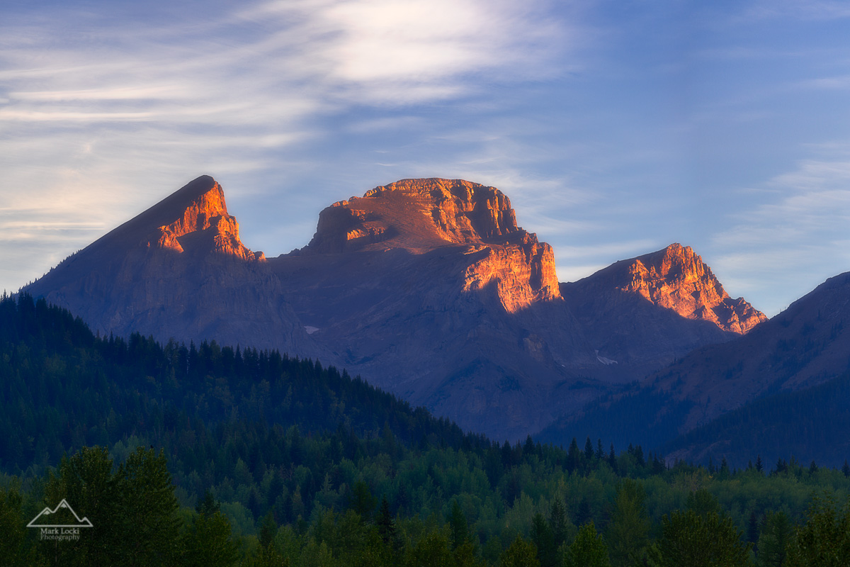 Three Sisters Summer: A summer sunrise on the Three Sisters above Fernie, BC