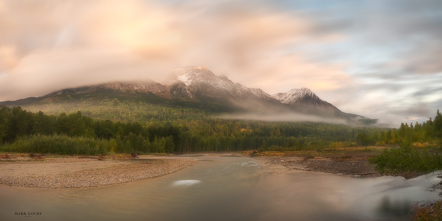 Hosmer Sunrise - The small community of Hosmer sits just north of Fernie along Highway 3.  The bridge over the Elk River at Hosmer has one of my favourite views in the Elk Valley.  After the first snowfall of the year in the mountains I went out looking for some sunrise shots.  While the peaks of the Lizard Range in Fernie were completely shrouded in clouds, just a bit further north some blue skies appeared and Mount Hosmer became visible.  A touch of sunlight on the peak and forest added to the beauty of the scene.  This panorama is a combination of 4 long exposure shots.
