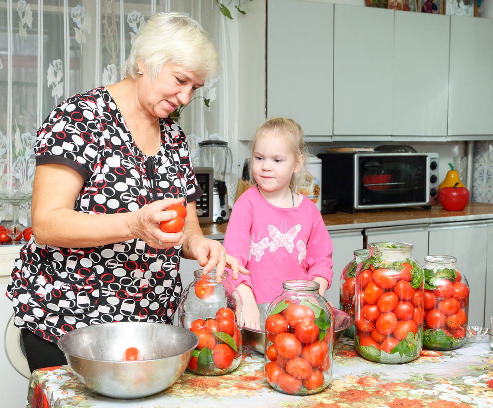 Generations of gardeners processing home grow tomatoes.