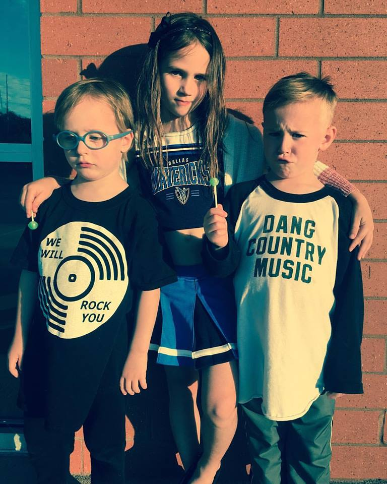 """Jessi's kids. One of the twins sporting the kid version-""""Dang Country Music."""""""