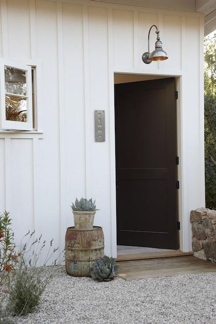 Same concept here-white board and batten and black front door